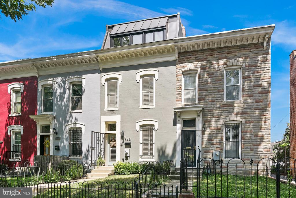 Accepting back up offers, open Sunday  2-4pm. Welcome to 642 I ST NE, a stunningly renovated row home situated in the heart of H Street Corridor and set over three extraordinary levels. Great care has been taken to blend the homes original character with a stylish mix of updates throughout, including new custom built-in book shelves, a completely renovated Chefs kitchen, premier decking, and so much more. Up the front steps and through the front door lies a welcoming foyer which leads into a bright and open living room with exposed brick and a fireplace. The living room leads to a dining space, a large area fit for a dinner party.  The gourmet kitchen is outfitted with a newly added breakfast nook, new double paned picture window, Carrera marble countertops, restoration hardware lights, custom cabinets, and a convenient pantry/closet space. Off the kitchen youll find a hidden powder room. Step outside to your oasis in the city- a private deck where one can relax and enjoy the scenery, tend to your urban garden, or dining al-fresco. On the second floor you will find three generously sized bedrooms, one of which being the first Primary Suite, with custom Elfa-shelving in the closet, built-ins, and an ensuite bathroom. Up to the newly built third floor addition, guests will find the second Primary Suite, complete with a spa-like en-suite bathroom with Ann Sacks tile and separate vanities. This bedroom is flooded with natural light, with over-sized windows, a fabulous window seat with tons of storage, and two custom Elfa-shelving closets. This level also offers a playroom/bonus room, and a fantastic new deck with brand new durable flooring- perfect for entertaining. Think at home office with grand views! And as an added bonus? The home offers secure parking! Located in the heart of vibrant H Street Corridor, residents will find themselves at the center of it all, close to both METRO, the Citys most sought-after shopping, dining and social destinations, and so much more.