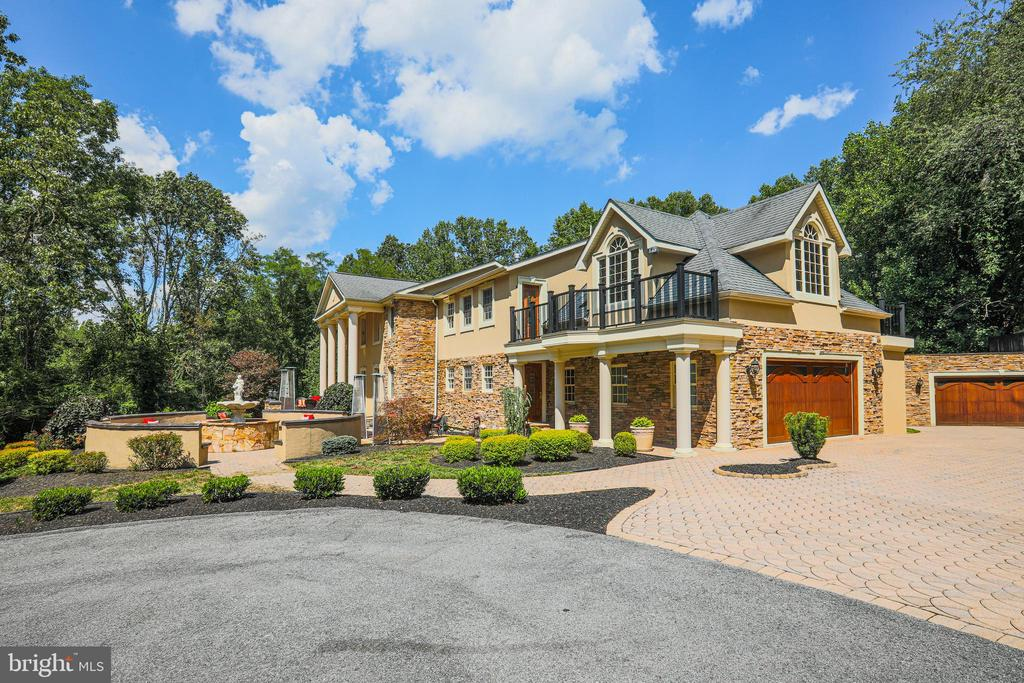 This exquisite one of a kind mansion sits on 4 acres of land with a private entrance gate.  It must be seen to be appreciated!  This beautiful home boasts 5 fireplaces, 3 master suites and, an in-law/ au pair suite with a full bath that is handicap accessible.  There is also a full gym and theater in the lower level.  A unique amenity in the home includes a cigar room with separate ventilation.  This extraordinary home offers numerous entertainment options; from a saltwater pool and sauna to the multilevel decks and patio.  The surrounding area offers a private park with a stream and is conveniently located 8 minutes from the Baltimore Ravens practice complex and only 25 minutes from downtown Baltimore.   You will surely be impressed!!!!