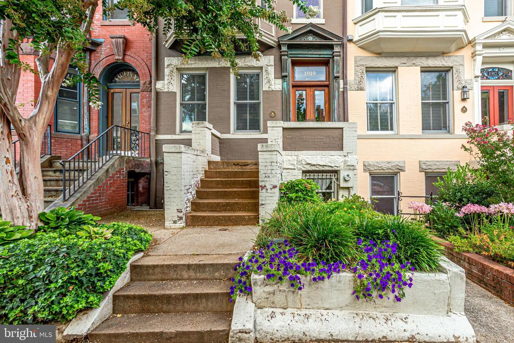 Situated in the heart of Dupont Circle, this elegantly appointed and large row home is ready for its next owner. Entering through the foyer you're met with the first of three large living spaces, with incredibly high ceilings and hardwood floors throughout. In the back of the home is an eat in kitchen which leads to (rare for Dupont) two parking spaces. Upstairs you'll find three spacious bedrooms, including the primary suite with two walls of closets, and gorgeously renovated bathroom with dual sinks. On the top level sits two more bedrooms and another full bath. Lower level in-law suite. 1919 S Street is uniquely positioned just steps from DC's most desirable neighborhoods. From historic Dupont Circle to the thriving nightlife and restaurants of Adams Morgan and 17th Street; the gorgeous parks and estates of Kalorama and the thriving social scene that is the U Street/14th Street Corridor, you'll be living at the confluence of DC's top culture, nightlife, shopping, and recreation spaces.