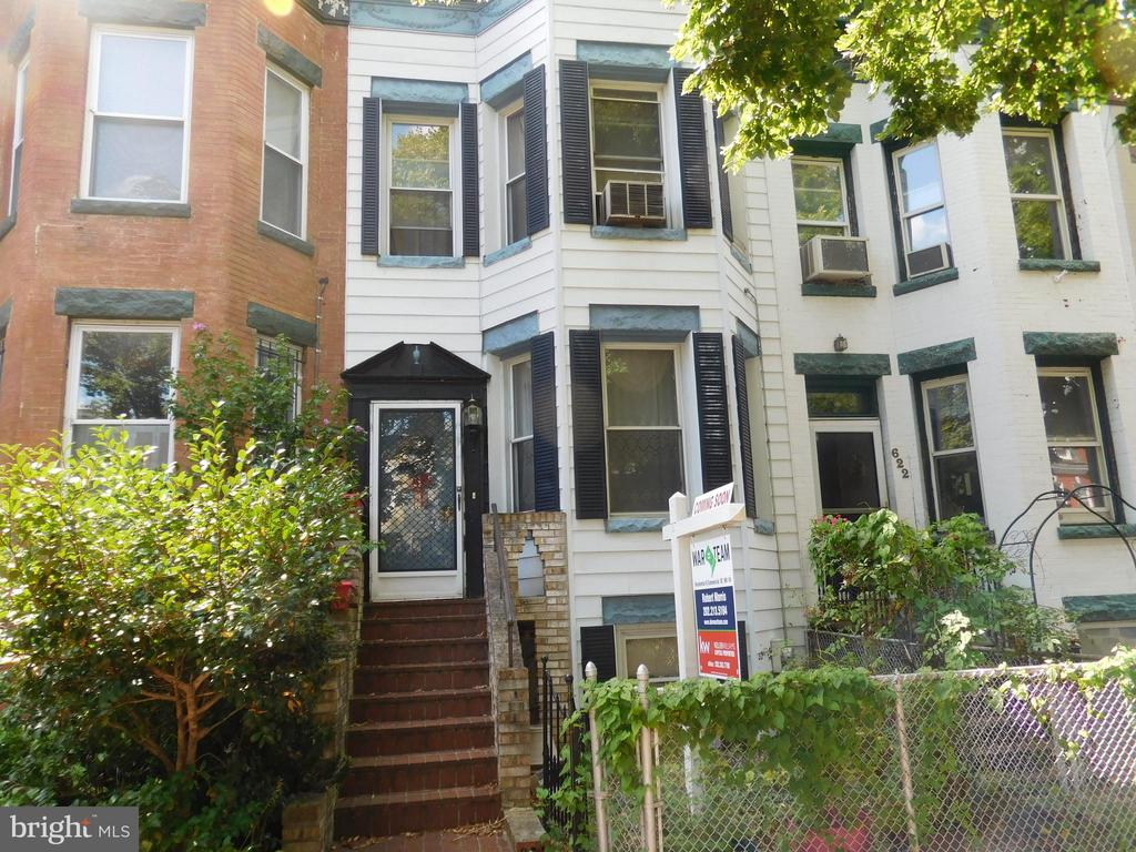 Investor's Dream! Lovely brownstone in Capitol Hill awaiting your vision.  Upstairs you will find three spacious bedrooms and bathroom. The main level comes with a living room, dining room, kitchen, half bath and hardwood floors throughout. Family room and walkout finish out the basement. Backyard is ideal for entertaining. Six block walk to Union Station Metro Center, H Street Corridor, restaurants and eateries. Cash or hard money preferred.  Sold as-is!