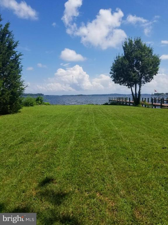 .39 Acres Of Spectacular Waterfront Property! Sunrise View Of The Magothy River. Large Level Lot With Bulkhead And Private Sandy Beach. Biggest Lot on the Street! Cozy Three Bedroom Two Bath Home Is Very Liveable and sold AS IS. Public Water and Sewer.  Upgraded Electric Panel.