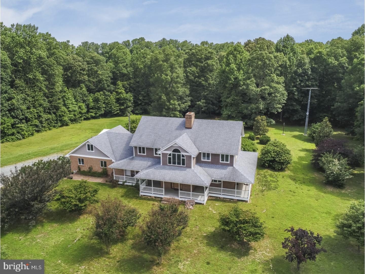 One of a kind custom built home that sits on 14+ Acres backing up to Hudson Branch Creek with beautiful, serene views.  Property has conditional use approval for a business plus two extra parcels of open space which can be used for farming, horses, goats, chickens, and so much more!  Along with the 8,400 Sq Ft home there is a 60 X 40 barn with a loft that has potential for 2 apartments and a 58 X 32 Lean-To, dog kennels and wood shed.  As you enter this home from the beautiful wrap around porch you will find features such as large gourmet kitchen with X-large island, ceramic tile floors and 11 X 10 Pantry.  23 X 11 Mudroom, 19 x 19 Sun-room, 3 sided fireplace and real oak wood 1 inch thick floors through out main floor.  2nd floor boasts 4 large bedrooms, a bonus room over garage that is currently being used for a business, but can easily be turned into an in-law suite.  The home is handicap accessible, and there is even an elevator, large enough for a wheelchair, that will take you to all 3 floors (no carrying laundry up or down stairs!!)  This home has so much to offer, you have to see it to appreciate.  What are you waiting for, make your appointment ASAP!!!