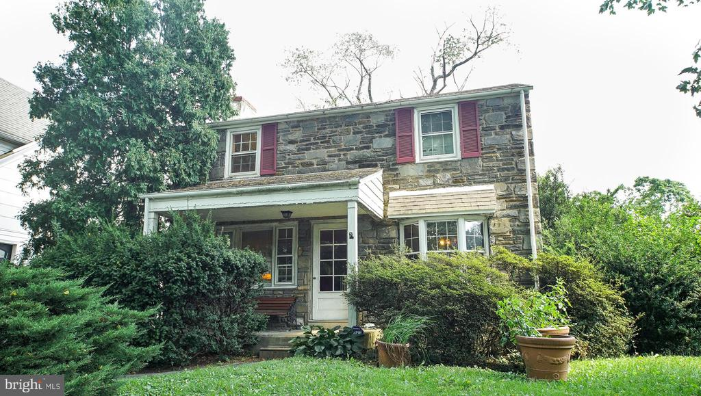 Owner investor alert! Have you dreamed of living in Lower Merion School District but haven't had the right opportunity? Now's your chance! Come check out this 3 bed, 2.5 bath home waiting for your flair!  This stone gem, located on a quiet street, greets you with plenty of curb appeal.  Walking up onto the concrete porch, you are surrounded by plenty of greenery and privacy.  Heading through the front door, you enter the living room brimming with tons of natural light.  There is also a fireplace, and beautiful hardwood floors.   Through the living room, there is a sitting room, with plenty of storage and a large, picturesque window.  To the right of the living room is a formal dining room, complete with hardwood floors and a large bay window.  Heading into the generously sized kitchen, there is endless storage possibilities, counter space, and tile flooring.  There is also access to the backyard, including a driveway.   The first floor also features a half bathroom.  There is also additional space, with a half finished basement, and full bathroom.  Heading up to the second level, there is a large master bedroom, and 2 other spacious bedrooms, along with a full sized hall bath.  The hot water heater is also only 1 year old.  Located close to City Ave and all it's shopping and dining amenities, what more could you want!  Check this out today before it's gone!