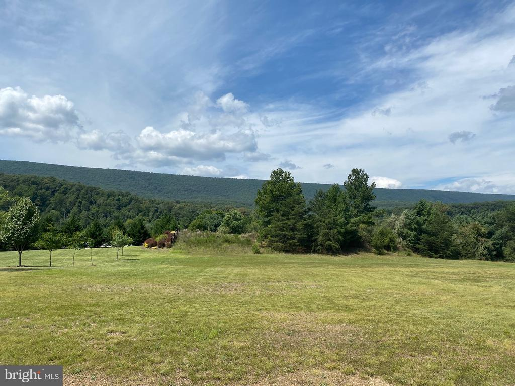 Beautiful Setting and View!  1.17 acres in Cacapon South Subdivision.   Located directly across the street from Cacapon State Park.   Enjoy the lake for swimming and fishing, 18 hole golf course, horseback riding, hiking and more!    Central sewer system and paved roads.