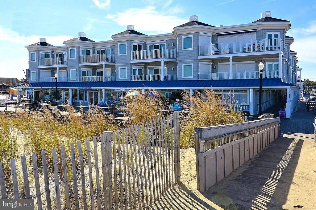 A rare offering, this luxury condo with unmatched direct views of the Atlantic Ocean is situated in the heart of downtown Bethany Beach in the highly desirable Residence at Blue Surf.  This high-end property features an open great room that spills onto a beachfront balcony to take full advantage of the views.  Listen to the ocean while watching the sunrise from your beachfront balcony and cool off in the community pool after a stroll along the boardwalk. The spacious master bedroom is positioned on the oceanfront and two additional bedrooms with en-suite baths provide comfortable space to entertain family and friends.  Complete with a private, gated entrance with two reserved parking spots and an elevator for easy access to your third-floor residence, this meticulously maintained property is appointed with exquisite furnishings and has been adored by one family.