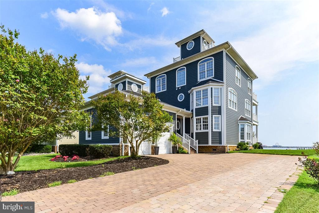 Breathtaking views of Ocean City's skyline await you in this bayfront 4 bed 3 ½ bath home with PRIVATE PIER. This awesome home features a great floorplan with the entire third floor as the master suite. . You'll never want to leave with bay views from every room. Multiple decks across the width of the back as well as a rooftop deck enhances your stunning viewing ability. Upgrades galore really make this a very special place.  Here's a few improvements in recent years and some great features to enjoy. All new siding, new shingles, new exterior accent lighting. Full kitchen remodel including electronic drawers from Blum, upgraded Miele appliances including a steamer/oven, Uline icemaker and beverage center, 2 freezer drawers, Bosch dishwasher, also new granite kitchen countertops with LED under counter accent lighting. New LG washer and dryer, all bathrooms have been updated with new tile, fixtures and toilets. All new recessed lighting throughout with Smart home and security system. New Kinectico water softener system and Culligan reverse osmosis system. This home also features your own private elevator.  Don?t miss out on this one; this is a very special place.