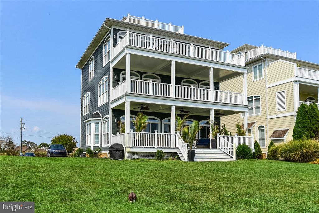 Breathtaking views of Ocean City's skyline await you in this bayfront 4 bed 3 ½ bath home. This awesome home features a great floorplan with the entire third floor as the master suite. High end furnishings from Bethany Resort Furnishings fill this home with the ultimate in comfort. You'll never want to leave with bay views from every room. Multiple decks across the width of the back as well as a rooftop deck enhances your stunning viewing ability. Upgrades galore really make this a very special place.  Here's a few improvements in recent years and some great features to enjoy. All new siding, new shingles, new exterior accent lighting. Full kitchen remodel including electronic drawers from Blum, upgraded Miele appliances including a steamer/oven, Uline icemaker and beverage center, 2 freezer drawers, Bosch dishwasher, also new granite kitchen countertops with LED under counter accent lighting. New LG washer and dryer, all bathrooms have been updated with new tile, fixtures and toilets. All new recessed lighting throughout with Smart home and security system. New Kinectico water softener system and Culligan reverse osmosis system. This home also features your own private elevator.  Don't miss out on this one; this is a very special place.