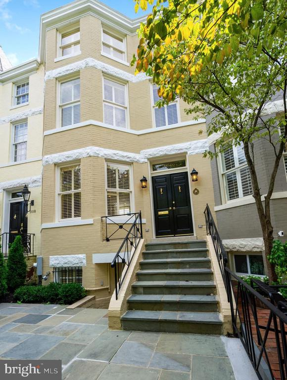 NEW LISTING  - EAST VILLAGE! Large and wide, fully restored townhouse with 2 CAR PARKING and lower level suite with separate entrance perfect for home office/ gym,  playroom  or nanny . Renovation/restoration of both interior and exterior just finished in June 2020 including a new heating system, a new AC and new water heater. The FIRST FLOOR design is open and gallery-like with 9+ foot ceilings and a double living room with antique pine wood floor, atrium windows, fireplace, and  gourmet kitchen with custom cabinetry and granite counters. The UPPER FLOOR boasts an owner's suite with 13-foot ceilings and large walk-in closet plus two additional bedrooms each with ensuite bathrooms, all featuring great natural light. The LOWER LEVEL offers a complete au-pair suite (or office/. gym) with private front and rear entrances, living room, a full kitchen, private laundry, bedroom and storage rooms. There is a charming flagstone above patio with new landscaping at the front of the house and two parking spots in the rear.