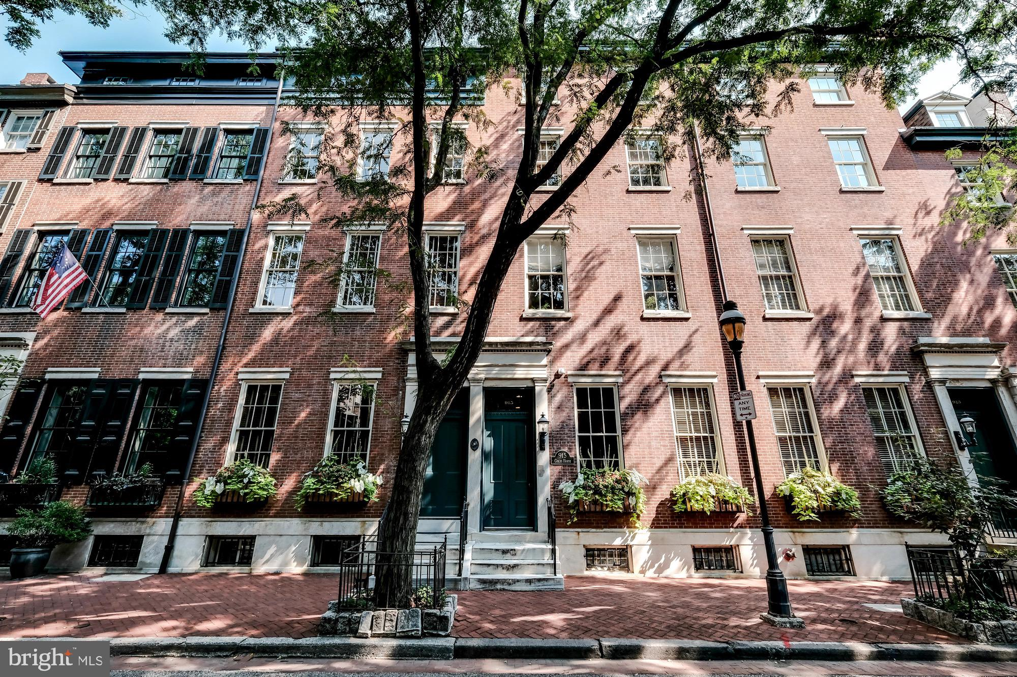 COLES HOUSE CONDOMINIUMS: WASHINGTON SQUARE'S premiere BOUTIQUE condominium property. This TWO bedroom, two and a half bath, bi LEVEL residence with wide-plank hardwood floors throughout, TWO PRIVATE DECKS and its OWN PARKING SPACE is a MUST SEE! Take the elevator up to PERFECTION. GRACIOUS, SPACIOUS, and OPEN living and dining area. Custom kitchen with ENORMOUS ISLAND and BREAKFAST bar, magnificent cabinetry, and high-end stainless steel appliances, including Wolf Range.  Dining area,that intimately accommodates two or ten, flows wonderfully into your light-filled SOUTH FACING living room. Upstairs Master bedroom with a wall of closets, custom built ins and elegant en suite bath, with double sinks, is fantastic!! Second well-proportioned bedroom and en suite bath can do double-duty as an office. Two decks with AMAZING views -- one with room for BBQ grill and dining.  Second private deck with space for relaxing, entertaining and dining. Both decks extend the living space for 6 months of the year.  Private parking space, with a direct entrance into the building and a basement storage cage make this residence a ONE OF A KIND opportunity. A quick walk to Pennsylvania and Jefferson Hospitals, Washington Square, and some of THE BEST dining.