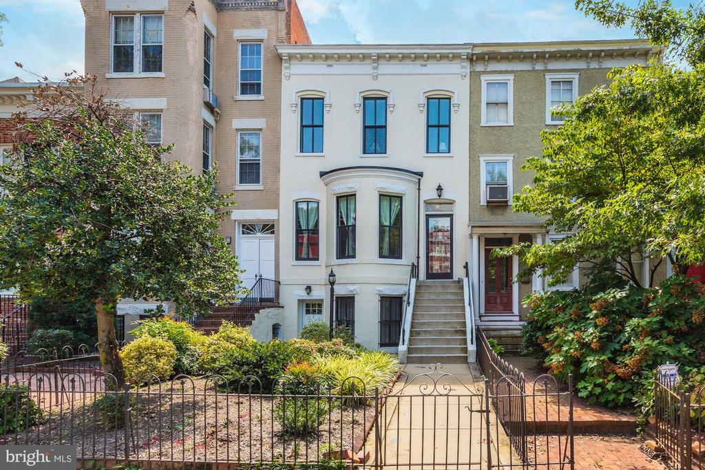 Whether you want to live in one unit and rent out the others, or rent out all three, don't miss out on this opportunity for a great revenue generator in the Heart of Capitol Hill.  Located just off Constitution Ave with street views of the Capitol, this multi-unit home was completely gutted and renovated in 2011 (new kitchens, bathrooms, completely new electric, floor & ceiling joist) and features three separate units. Each unit comes complete with a private/secure entrance, outdoor space, and in-unit washer/dryers. Unit#1 is located on the ground floor and includes two oversized bedrooms, one bath, an eat-in kitchen with breakfast bar, and a spacious living room. Unit #2 is accessible through the main entrance of the home and features 2 bedrooms, 1 full bathroom, an eat-in kitchen, and a spacious living room. Lastly, unit #3 offers two bedrooms + den/potential 3rd, 1 full bath, eat-in kitchen, and a spacious living room. Situated blocks to Eastern Market, H Street Corridor, Lincoln Park and just around the corner from numerous restaurants, cafes, and Metro this poses as an ideal location.