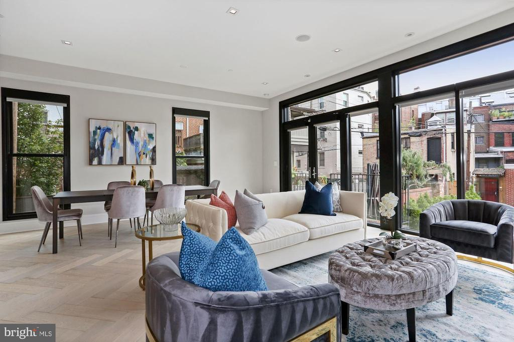 Stunning 2BD/2BA luxury condo in the heart of Logan Circle! This sun-filled, contemporary unit checks every box. Enjoy elevator access directly into the unit, wide plank herringbone hardwood floors, 10' high ceilings, floor to ceiling windows, spacious rooms, Snaidero kitchen design, Waterworks bathrooms, & Bespoke custom finishes. The chef's kitchen is perfect for entertaining, boasting custom cabinetry, waterfall island, marble countertops & backsplash, Wolf stainless steel professional appliances, and SubZero refrigerator & wine cooler. This condo features a spacious Primary bedroom with ample closet space and a beautiful ensuite bathroom as well as an additional generous bedroom and bathroom. The unit includes a rear stone terrace and 1 assigned parking space. Just off Logan circle and walkable to Le Diplomat, Whole Foods, and countless restaurants, shops, and local attractions.