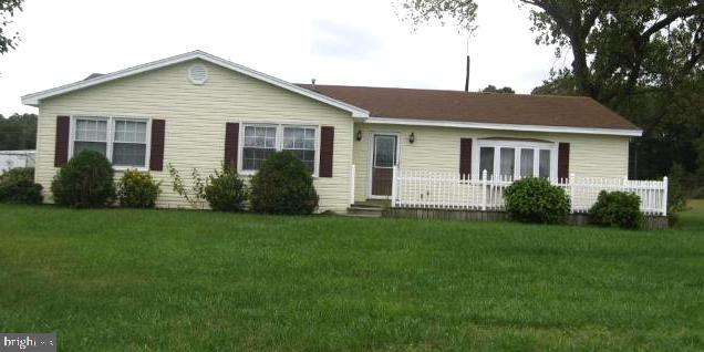 Nice rancher located not far from town.  Credit report (must be at least a 600 credit score), references, security deposit & first month's rent required. Tenant will have use of yard surrounding house and a shed. Please use the RentSpree link in the listing to complete an application - cost will be $30.00.