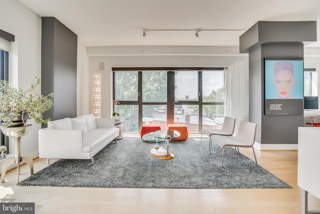 Corner Unit at Q14 in Logan Circle | 2 Bed | 2.5 Bath | 1 Home Office | 1,390 Sf | 2 Balconies | 1 Parking Space | Building: Built in 2007, 28 Residential Units & 2 Commercial Units, Common Rooftop Deck, Party Room w/ Outdoor Terrace with Grill, Extra Storage Available | Unit: Corner Unit, Lots of Natural Light, 33 Linear Ft of Windows, 2 En-Suite Bedrooms, Walk-in Closet w/ Built-Ins in Master Bedroom, Custom Roller Shades, Open Floor Plan, Plenty of Storage Throughout, Hardwood Flooring Throughout | Kitchen: Peninsula w/ Storage & Seating Space for 4, Absolute Black Granite Countertop, Custom Pendent Lighting, Stainless Steel Appliances, Porcelanosa Cabinetry, Appliance Garage, Sub-Zero Fridge, Jenn-Air Gas Range, Full-Size Bosch Dishwasher | Baths: Master Bath renovated in 2015, Dual Sink Vanity w/ Leather Finish Granite, Storage in Master Bath, Heated Floor in Master Bath, Dornbracht Faucets, Glass Stall Showers