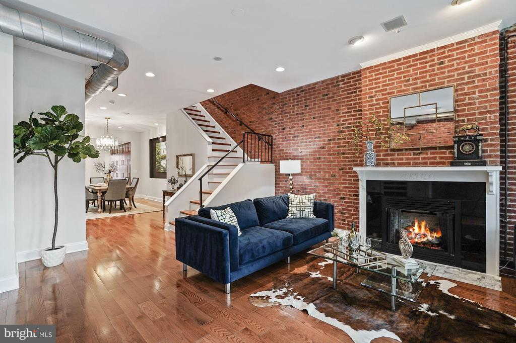 OPEN HOUSE Sunday 09/27 --1:00-3:00 pm.  Must See in Bloomingdale with separate income unit --- Beautifully Renovated four level Grande Dame  -- 2307 1st Street Welcomes you Home with Carrara marble tile entry, exposed brick walls and open Living Room featuring Gas Fireplace and Bay Window.  Step through the Dining Room including a wine closet and  flow into The Gourmet Kitchen - featuring Calacatta Quartz,  Professional Appliances w. Range Hood & Restoration Hardware Fixtures.  Gorgeous full wall height cabinetry and storage spaces on all of the Kitchen walls.  Entertain on your brand new TREX - composite Deck - perfect for Al-Fresco Dining and Entertainment.  New Wide-plank Oak hardwood flooring throughout the home.  The upstairs  level features two spacious Bedrooms, second Fireplace and simply Fabulous hall Bathroom - Timeless polished Marble tile work  + Restoration Hardware Fixtures and ToTo commode.  The bright fourth floor includes bedroom three with Juliet Balcony and en-suite Bathroom.  2307 1st Street provides fantastic private outdoor entertaining spaces between the NEW Main level Deck + Fabulous Rooftop Deck - one of the highest points in Bloomingdale - rarely found and truly coveted views of DC.  You must see yourself! The lower level includes completely separate 2 bedroom, 1 Bathroom (with C of O!) unit presently generating $2250/month.  Attached Garage Parking completes the picture.  Visit the 3D Model:  http://spws.homevisit.com/hvid/308235  --- Contact Agent to arrange Private Tour.
