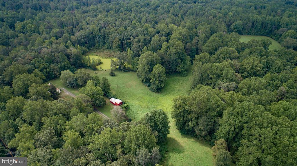 Beautiful level/rolling acreage.  Great opportunity for development. Parcel of Land consisting of 206.75 acres zoned A-1 including parcel 16-35A, w/ Trees, fields and pond. Offering Recreation, Hunting , Riding. Dwelling, out buildings and barn-or build your own Estate. Development Potential w Road Access Zoned A-1= 3 Acre/Lots, w /No proffers. Lot can include Resource Protection Areas. Currently house at front entrance,  great for rental income . . Located on state maintained road. In land use. Great location only 12 miles from I-95  Garrisonville exit and minutes from RT 17.