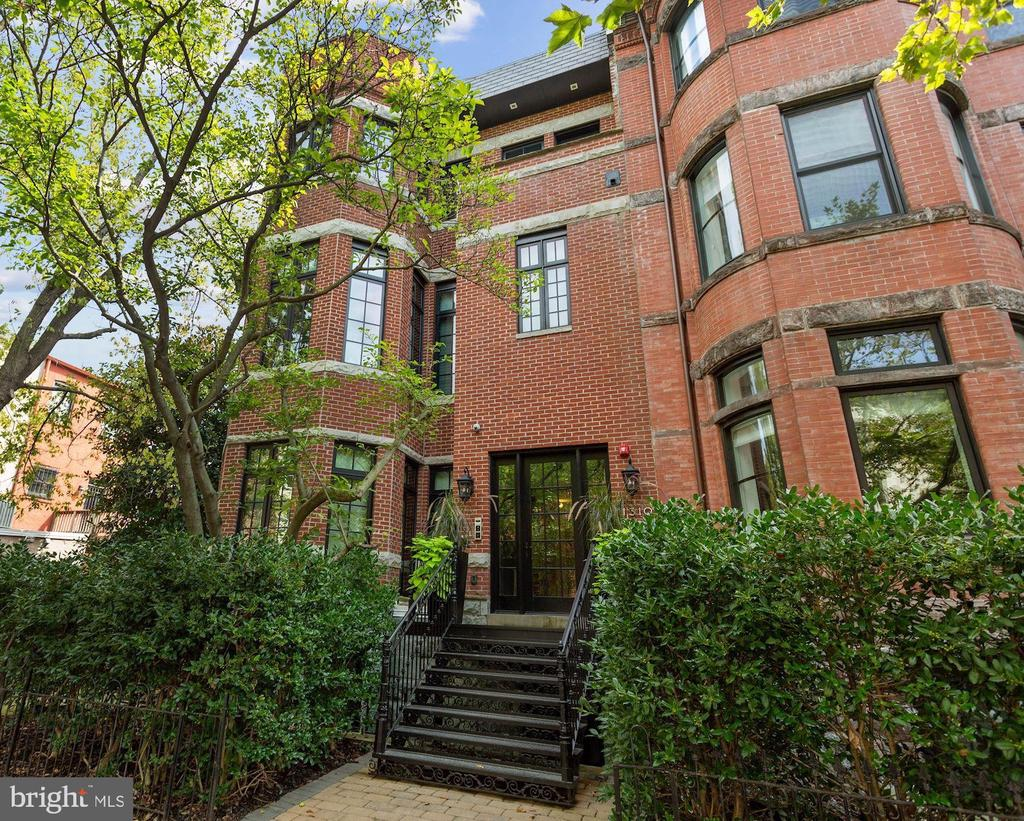 Stunning 2BD/2BA luxury condo in Logan Circle! This sun-filled, contemporary unit checks every box. Enjoy elevator access directly into the unit, wide plank herringbone hardwood floors, 10' high ceilings, floor to ceiling windows, spacious interior spaces, Snaidero kitchen design, Waterworks bathrooms, & Bespoke custom finishes. The kitchen boasts custom cabinetry, waterfall island, marble countertops & backsplash, Wolf stainless steel professional appliances, and SubZero refrigerator & wine cooler. This condo features a spacious Primary bedroom with ample closet space and a beautiful ensuite bathroom as well as 1 additional generous bedroom and bathroom. The unit includes a rear stone terrace and 1 assigned parking space. Located in the heart of Logan circle and walkable to Le Diplomat, Whole Foods, and countless destinations.