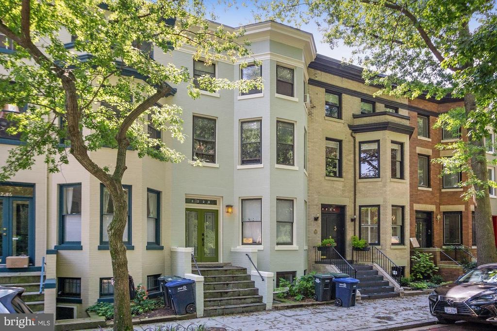 Kalorama Heights, Kalorama nights! Enjoy one of DC's most sought after neighborhoods in this 3-unit townhouse: lower level 1 bedroom unit, main level 2 bedroom unit, and upper level 2 bedroom duplex unit. This rare property is ideal for a savvy owner who desires multiple ownership options. Flexible lease terms allow for a wise investment with consistent cash flow ($97,000+ annually) or own as a pied-a-terre, keep one unit for personal use while renting the other two units. Also, owner occupants can use as a primary residence. This very handsome property features formal dining rooms, hardwood floors, polished limestone gallery floor on ground level, professionally installed lighting, updated kitchens with gas cooking, 2 fireplaces, and an abundance of outdoor space with 1 patio and 2 screened porches. Take advantage of endless versatility in one of the city's best zip codes!