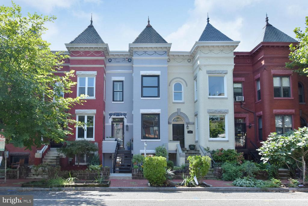 """PRICE IMPROVEMENT! OH 1-3PM SUN; Truly exquisite two unit property (with C of O!) on Bloomingdale's best block only .5mi to Shaw Metro and a block to Michelin-rated The Red Hen and so much more! This stunning turn of century Victorian Bayfront rowhome was gut renovated with the finest craftsmanship in 2015 and has been dramatically enhanced with designer details and smart upgrades in every conceivable way during the current owner's stewardship of the property.   The upper unit is a 2BR (BOTH SUITES!)/2.5BA  masterpiece that spans 1850 square feet on two finely curated levels each with its own 130 square foot south facing rear deck. The main level enjoys phenomenal light from oversized windows and feels both intimate - due to its perfectly proportioned spaces - and expansive with its soaring 10' ceilings and open sightlines throughout the space. Designed with the ultimate blend of timeless elegance and modern style, the upper unit of 132 Seaton Place NW boasts shell stained wide plank flooring, exposed brick, a wood burning fireplace with marble surround in the living room, an open chef's kitchen with Viking SS appliances, marble counters and white lacquer cabinetry and a separate dining and family room.  Custom moldings, lighting and window treatments adorn every room. The upper level consists of two bedroom suites, including an owner's retreat with custom cabinetry by Maurice Villency, an enormous walk in closet and a drop dead gorgeous bathroom with marble hex tile flooring, a 5 jet spa shower with modern, large format wall tile and frameless glass door, a clawfoot tub and south facing sun deck with retractable awning.  The upper level also enjoys a separate laundry room equipped with a full sized front loading W/D, a sink, a tankless """"instant hot"""" hot water heater and the unit's separate HVAC system.  An additional 250 square foot finished loft space provides incredible storage- another rare feature for a two unit property. Secure off street parking for a large S"""