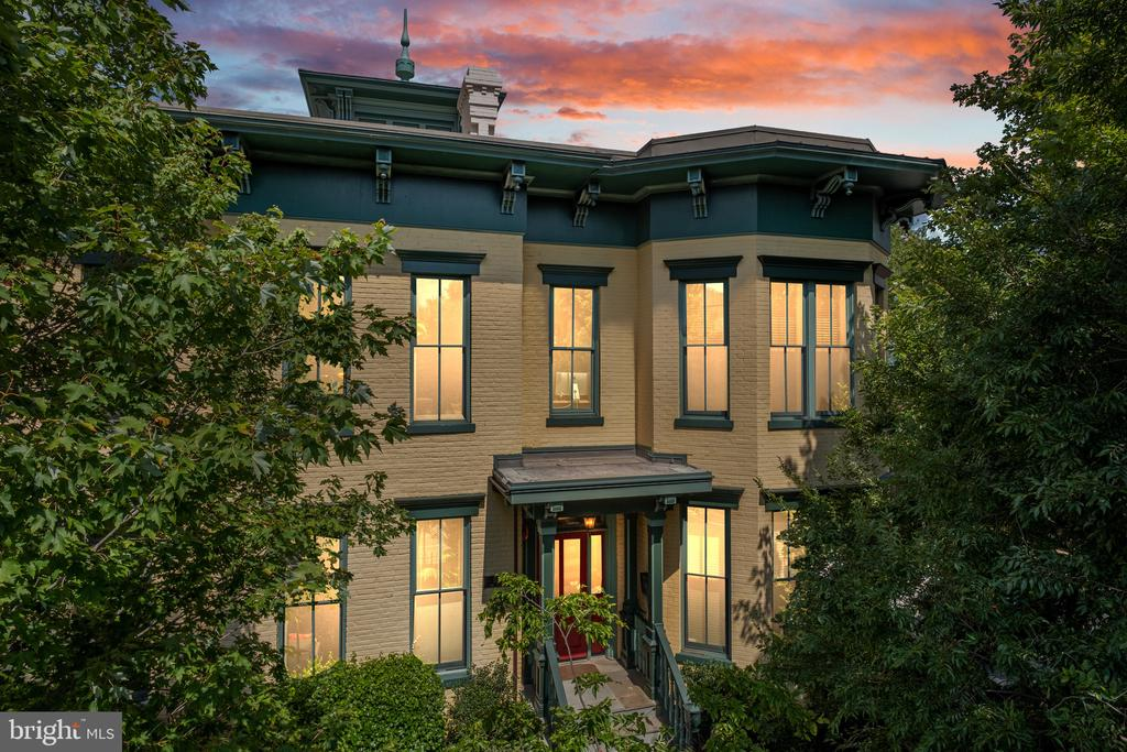 As seen in the 2018 LeDroit Park Home and Garden Tour and in the Washington Post, this picturesque yellow brick home is a prominent neighborhood hallmark. Beyond its storied allure, though, 531 T St NW #203 is an enchanting two-level condo that's as special inside as it is recognizable to the outside world. The homes vibrantly colored facade framed by the iconic LeDroit Park wrought-iron fence sets the tone for what youll find within: a one-of-a-kind residence where character meets creativity like never before. Inside, soaring Cathedral ceilings, new hardwood floors, and walls of windows welcome you into this magical space thats designed to inspire. Outfitted with gas cooking, custom tiling, stainless steel appliances, granite counters, and an accompanying bar set-up, the kitchen has everything you need to serve up both unforgettable events and everyday gatherings. The entire home has been recently reimagined over the past several years, with renovation costs exceeding $100,000. Enhancements include: an HVAC/furnace replacement, expansive in-unit storage, updated bathrooms with Spanish-style floors and subway tiling, new Venetian blinds, luxe carpeting throughout, and brand new light fixtures installed in the living and dining areas, kitchen, and guest room.  The homes two spacious bedrooms one complete with an en-suite bath are immersed in natural light and built for relaxation. And just around the corner, discover an additional loft living space that's the ultimate movie night backdrop or workspace based on whatever your needs require. Full of surprises at every turn, this lofty space also boasts a built-in bookshelf that gives way to a hidden meditation room, a place to unwind and recharge in complete and utter privacy. The upper staircase leads to the units historic Cupola, a space that makes room for yet another office surrounded by windows and scenic views thats worth staying home for. Situated where LeDroit Park meets Shaw, residents here can enjoy the tranqu