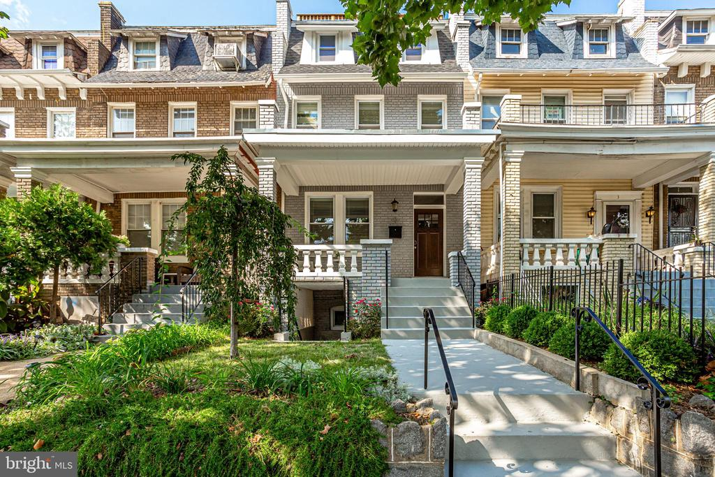 OPEN SUNDAY from 1:00-3:00PM. Bloomingdale Beauty with private roof deck! This classic 1923 DC rowhome has been meticulously updated for 21st century living.  The main level features a wide open living space flooded with light. The large living and dining room feature tray ceilings, exposed brick and flowing hardwood floors. The chic kitchen boasts classic white Shaker style cabinets and Carrara marble counters.  Double glass doors lead to the back deck and parking.  The second floor features a stunning owner's suite with soaring ceilings and an en suite bath with dual vanities. The second and third bedrooms are generously sized and perfect for guests, a nursery, or home office. Head up the spiral staircase to the massive private roof deck with sweeping city views. The fully finished basement is the perfect in-law suite with front & rear entrances, a full kitchen,  W/D hook-up, additional bedroom, and full bath.  The private parking in the rear includes electric car charging too!  Perfectly placed in the heart of Bloomingdale, the home is three blocks over from the neighborhood's hidden gem, Crispus Attucks Park. Just moments from DC favorites like Red Hen, Tyber Creek and Big Bear Cafe, your food and entertainment options abound. The upcoming McMillan Reservoir redevelopment will add even more neighborhood amenities. Square footage is estimated per professional measurements.