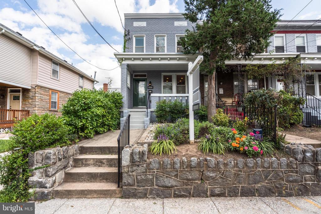 Gorgeous, updated, spacious end unit row home in Brookland.  With all the important aspects having been fully remodeled over the past 4 years, this home will delight from the start.  Hardwood stretches throughout the main level's living, dining and kitchen, and upstairs to the three bedrooms.  The kitchen has been thoughtfully renovated with high-quality custom cabinetry, and the powder room is sophisticated and modern. Upstairs, the owner's suite has been remodeled with a gorgeous marble bathroom with large shower, and the second bathroom does not disappoint.  Elfa closets maximize storage in the closets. Downstairs, gorgeous built-ins create a perfect second living space, and with a full bathroom and a walk-out to the back yard, the space is extremely flexible.  The kitchen has updated sliding doors which lead out to a trex deck, garden, and parking for up to four cars. Close to Brookland and Rhode Island Metros, Edgewood Rec Center, countless restaurants, bars, grocery and hardware stores, the location is the perfect mix of convenience and calm.