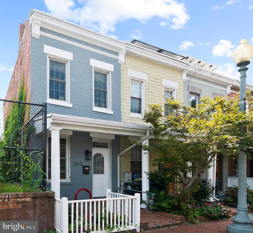 **TWILIGHT OPEN HOUSE: FRIDAY (10/2) 5:30PM - 7PM & OPEN HOUSE ON SUN (10/4) 1-4PM** NEW PRICE! $15K PRICE REDUCTION. You'll love calling this charming 2BR/1BA LeDroit Park rowhouse home! This renovated end-unit features a welcoming front porch, hardwood floors, and a fresh coat of paint. The living room has tall ceilings, exposed brick, and functional built-in storage. The main level of the home also features an updated kitchen with NEW stainless appliances, gas cooking, granite counters, and direct access to your private backyard. The fenced backyard is the perfect place to entertain, relax, or plant your own garden in the city! Upstairs, there are two bedrooms each with its own ceiling fan and organized closet, a full bathroom, and a W/D. The location really can't be beat - located on the edge of the Park at LeDroit, you're just steps to the new Whole Foods, Metro, restaurants, nightlife and so much more!