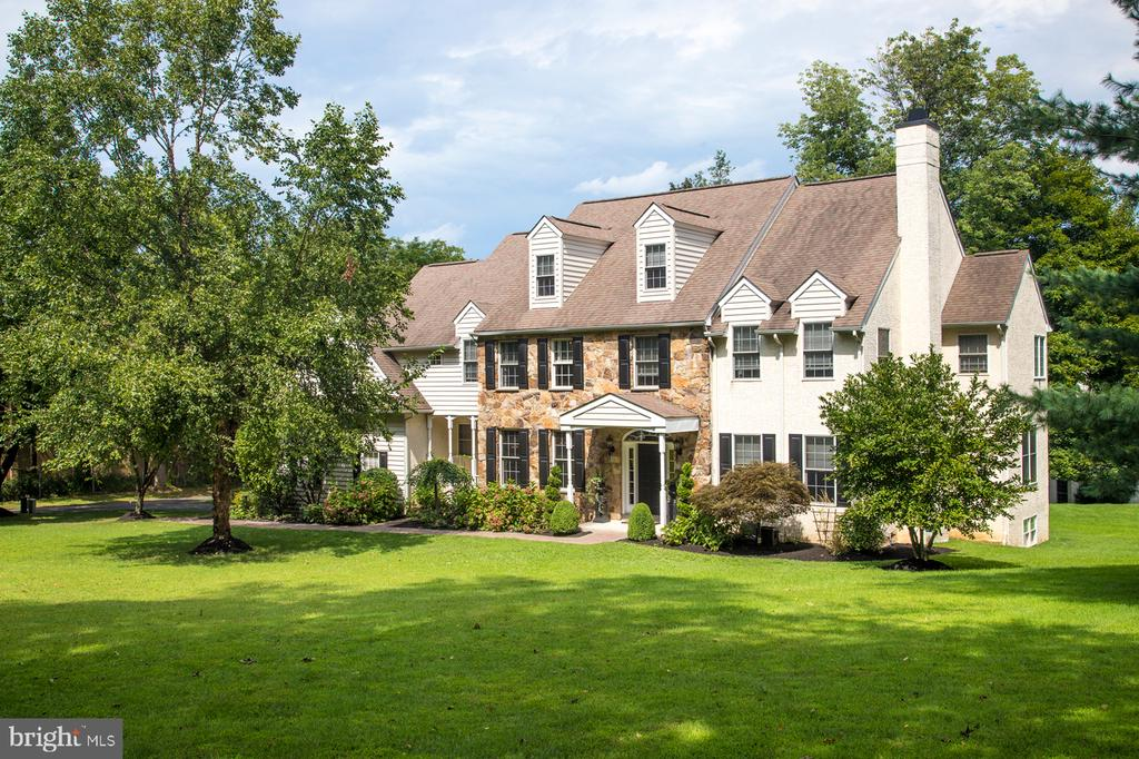 Better than new construction, this Villanova jewel offers it all for the discerning buyer, like sprawling green spaces, generous interiors, charm & upgrades galore! As if it came straight out of a designer magazine, 2075 County Line Rd impresses inside and out. The stunning home sits on expansive private grounds which is a rarity in Lower Merion Twp. The gracious flow and keen attention to detail found in every room will make you fall in love the moment you see it. Owned by a certified decorator who made each enhancement with care, no expense was spared in the refined design and selection of fit & finishes found throughout.   Come experience the comfort and elegance of this classic center hall colonial that greets you inside with a soaring 2-story foyer & sweeping staircase. The house was built for entertaining and raising a family, boasting a seamless flow from the kitchen to the dining room, great room & living room. Hosting gatherings is equally alluring out on the rear deck, spacious new stamped concrete patio, and nearly an acre of lush property – perfect for lawn games, a playset, party tent, pets, even a pool if you want one! Upgraded exterior lighting & professional landscaping enhance the ambience.   This move-in ready gem is brimming with high-end upgrades such as new hardwood floors, new carpeting, designer wallpaper & more. The large living room enriched by a marble fireplace, beautiful moldings & millwork connects to an oversized den/office overlooking the rear grounds. A huge family room with new gas fireplace & vaulted ceiling opens to the breakfast room & gourmet kitchen, a favorite gathering spot. Chef's quarters are appointed with updated cabinets, new granite countertops & backsplash, a big island, and premium Viking & Sub-Zero appliances. Step out sliding glass doors to enjoy the lovely deck. A butler's pantry serves the wainscoted dining room accentuated by a chic Restoration Hardware chandelier & authentic barn door! Also between the kitchen & 