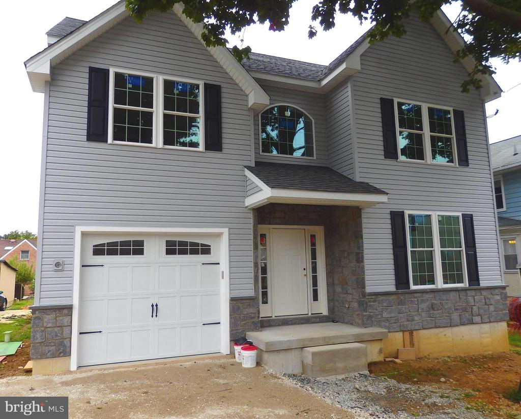 "Quality Custom Built New Construction in Ardmore is 85% complete.  Covered front porch opens into two story entrance foyer, hallway, living room, dining room, pantry closet, butler's pantry with sink, kitchen with 42"" wall cabinets, granite counter tops, tile backsplash, large island, Bosch appliances, breakfast room, family room with fireplace and slider to deck, hallway access to mud room area with closet & bench, garage access and powder room.  Beautiful on-site finished hardwood floors and quality millwork throughout the first floor.  Open stairway leads to the second floor with spacious main bedroom with tray ceiling, double closet, laundry, walk in closet and lavish master bath with large shower, double sinks, soaking tub, three additional bedrooms and hall bath with double sinks.   Unfinished lower level with an egress window and very high ceilings offers potential for additional living space space.  Gas Hot Air Heating system, central air,  gas hot water heater, 200 Electric Service and Pex plumbing system.  Desirable location near all Main Line amenities, shopping & entertainment nearby in Suburban Square such as the Ardmore Music Hall, Sam's Brick Oven Pizza, Trader Joes's, Tired Hands Brew Cafe, Whole Foods, Carlino's Italian Market, Marone's.   Walk to Chestnutwold Elementary School and a variety of libraries and parks such as South Ardmore, Merwood and Elwell.  Close to Ardmore High Speed Line R100 and  Ardmore Station R5 on the Paoli-Thorndale Line.  Easy access to Route 30, Blue Route(476) and Turnpike.  Less than 30 minutes to King of Prussia, Center City, and Philadelphia Airport.   Please note:  The home next door on the driveway side of this home will be rehabbed and sold in October, 2020."