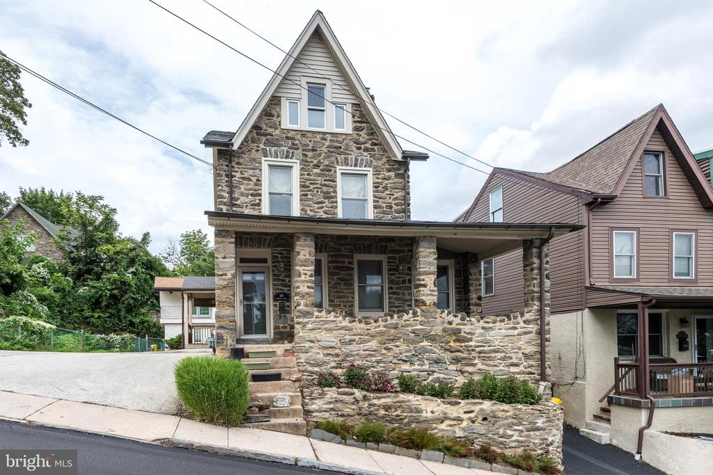 Literally ~Rock-Solid~, this well-loved and well-cared for stone single features- 4 Bedrooms and the most breathtaking view of the Manayunk Valley (short walk to Main Street!) from the front porch.  Open Concept 1st floor features Hardwood floors, living room and dining room, and a separate office with custom built-in desk and cabinetry. Continuing to the kitchen, you will find a wonderful island with lots of storage and space for seating. Stainless Appliances, Corian Counters.  A nice half bath, and a mud room/laundry room with plenty of room for storage. The 2nd floor has 3 Bedrooms, and a Full Bath with neutral tile throughout. The Master Bedroom has a full wall of Custom Built-In Closets. The 3rd floor contains a Large Bedroom and a Bonus Room that could be a bath or more storage. Everything has been redone over time as it was beautifully maintained by its current owners and cared for by all recent tenants.  No yard to maintain, the Belmont Hills Pool around the corner, several Parks, & Bala Cynwyd Trail, you have endless outdoor activities close by.  Lower Merion Schools and transportation nearby too.  Check out the Virtual Tour!  https://my.matterport.com/show/?m=dXVP7hX8kqA&mls=1