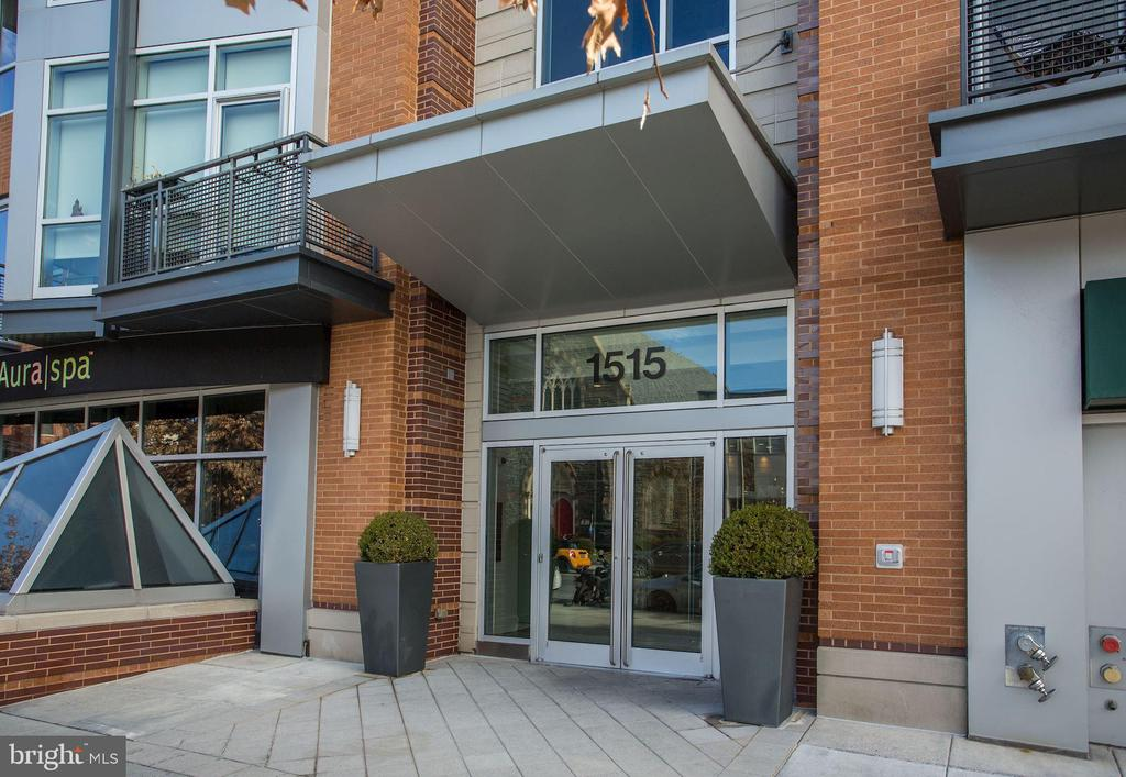 Open House 10/25 from 1-3pm.  The ultimate sophisticated duplex in the heart of Logan Circle!  A much sought after corner unit at the chic Metropole, this duplex is defined by stunning architectural features & open-concept space.  With 2 large BRs, 2BAs, a powder room, garage parking & storage, the home offers the trifecta of sophisticated style, terrific livability, and a walk-score of 97!  The unit is flooded with light from soaring, south-facing windows. There is a sleek gourmet kitchen that features premium SS appliances & high-end cabinetry.  The open living room and dining room offer great entertaining space.  There is a 1st floor balcony & powder room. The spacious master BR has a generous walk-in closet & spa-inspired BA, while the second BR also has an ensuite BA. The Metropole sets the standard in luxury condos, with on-site concierge, guest suites, courtyard lounge with grill, & is pet friendly. In the heart of Logan and across the street from Whole Foods, near the metro & fab Logan Circle... the location is unbeatable!