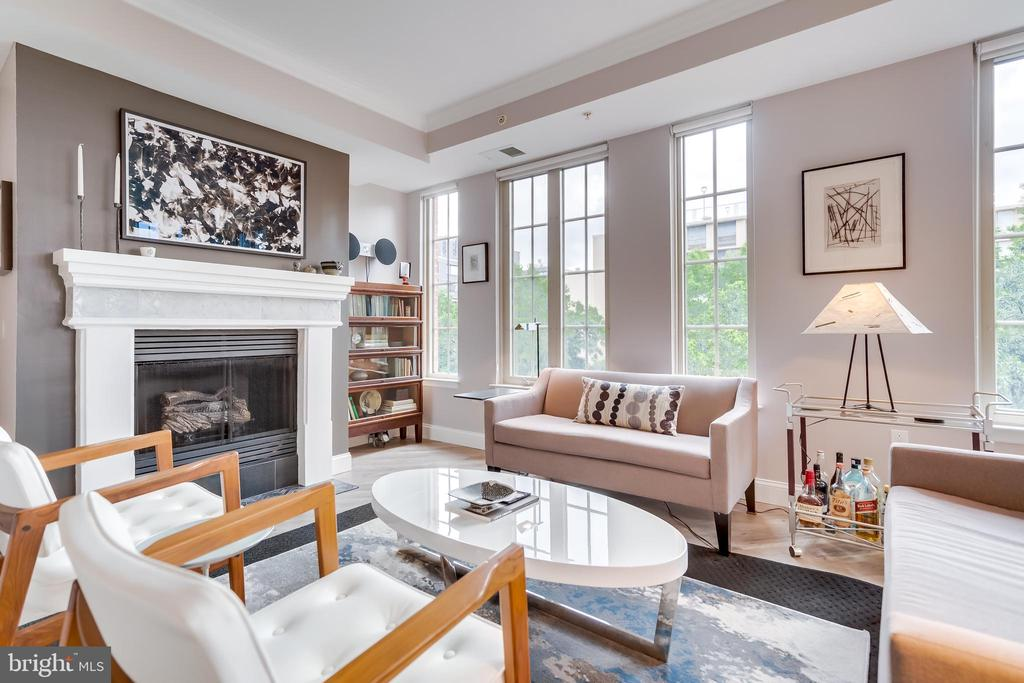 Designer 3 Bedroom in Logan Circle | 3 Bed | 2 Baths | 1,323 Sf | 1 Separately Deeded Garage Space | Building: 157 Units, Full-Time Concierge, 2 Elevators, Fitness Center, Party Room / Entertainment Center, Courtyard | Unit: Fully Renovated in 2017, Corner Unit, Wide Plank Vinyl Flooring, Designer Lighting, Walk-In Closets w/ Built-Ins, Frameless Glass Enclosed Shower, Plenty of Storage Throughout, Custom Roller Shades, Ann Sacks Tiles in Entry, Fireplace w/ Custom Mantle & Screen, Separate Living & Dining Spaces, Open Floorplan, Washer & Dryer (almost new) | Kitchen: Porcelanosa Kitchen including: Miele Professional Stainless-Steel Appliances, Built-In Miele Coffee Maker, Moveable Kitchen Island w/ Storage, White Solid Surface Krion Countertops, Ceramic Tile Backsplash, White & Dark Walnut Cabinetry, Full Size Dishwasher, Gas Cooktop | Bathrooms: Vanities w/ Storage, Ann Sacks Tiling, Full Size Tub, Koehler Toilets