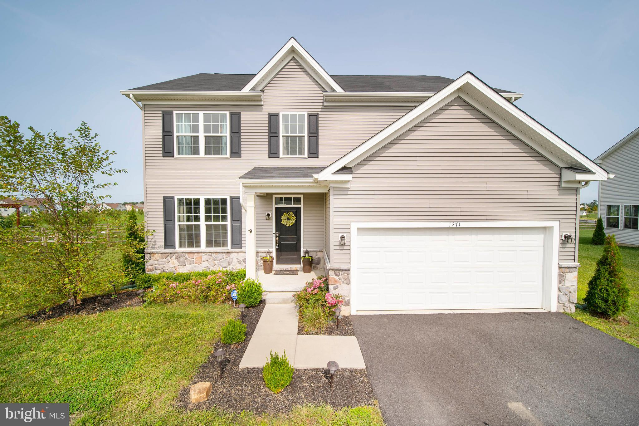 "Nothing left to do but pack your bags and move in!! If you're in search for a STUNNING, move-in ready 5 bedroom, 3.5 bath single family home in the Middletown area - this is THE ONE! Located in the desirable Hyett's Crossing community and offered at a fantastic price with TONS of UPGRADES and OPTIONS, this home is sure to wow! BONUS, this street is conveniently connected to the Village of Bayberry which will allow you to enjoy easy walks, trails and parks! This home is only 3 YEARS OLD with many of the items in the home still under warranty for added peace of mind. Enter this gorgeous home and you'll immediately fall in love with the bright and open foyer with wide-plank hardwood floors throughout the entire first floor. As you walk a little further, admire the main level open floor plan with recessed lighting - which features a spacious family room with a custom 60-inch linear gas fireplace, customized concrete fire place mantle, in ceiling surround sound system, half bath and spacious dining area with lots of natural light! The spacious kitchen boasts 42"" soft close white cabinets, custom over island light pendants, gorgeous granite countertops, an enormous island, and energy star stainless steel appliances including a double wall oven! Just off this area is a large dining room with access to your 2-car finished garage with epoxy flooring! This level also has easy access to the backyard, which features a large trex deck and large half-moon stamped concrete patio for the entertainers. Backing up to open space, the outside entertainment space allows you to enjoy beautiful sunsets from your backyard.  Make your way upstairs and you're met with a cozy loft with more recessed lighting- providing extra space for entertainment and relaxation! Down the hall you'll find your laundry room, a hall bathroom with jack and jill sink and combo tub/shower bath, and 4 spacious bedrooms including a master suite. The master suite features an en suite bathroom with a double sink, a tiled spa-shower with a seat and 2 large walk-in closets. The 2nd floor and basement of the home has like new plush carpeting. Already sound like a dream? Well, there is MORE! This home also comes with a full, finished basement complete with another bedroom with walk in closet,  full bathroom with tile floors and shower, and additional area with recessed lighting to make entertaining a blast! In total, this home has over 3,000 of functional living space with countless amazing features - all at a wonderful price! Don't miss your opportunity to tour this GEM today!"