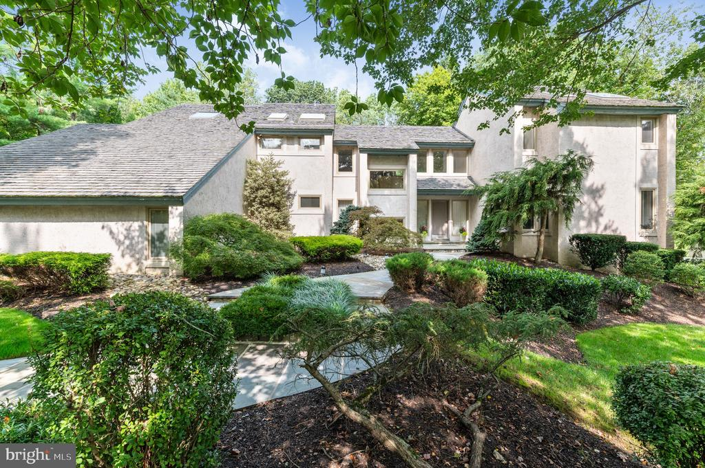 Stunning contemporary home with extraordinary architectural elements in sought after Ravenscliff.  Soaring ceilings, oversized windows and numerous skylights create a light filled home with amazing spaces for taking in the views of the outdoors.  In a sea of farmhouses this modern beauty truly stands out.   Nestled on a private, wooded lot with mature landscaping and specimen plantings this home is a true retreat.  The first floor features a dramatic entryway, a large living room with a fireplace and  wet bar area perfect for entertaining family and friends.  The sunken formal dining room features a dramatic wood ceiling and is just off the kitchen.  The incredible kitchen is sleek, functional and beautiful with a large breakfast room flanked by windows and fabulous views of the yard and pool.  Open to the kitchen is the family room with a  floor to ceiling stone fireplace, built-ins and cozy wood beams.  There is also a mudroom and laundry room on the first floor just off the attached 3 car garage.  Upstairs you will find the master bedroom with a pristine, remodeled master bath complete with 2 sinks, a walk-in glass shower and soaking tub.  There are 3 additional bedrooms on the second floor with a large remodeled full bathroom.  The finished lower level features an additional family room that opens right out to the gorgeous backyard and fantastic pool.  The 5th bedroom is also in the lower level and is the perfect spot for guests or an au-pair suite.   A large full bathroom with a sauna and separate water closet completes the lower level.  Located in the award winning Radnor School district, close proximity to downtown Wayne with it's many shops and restaurants, close to public transportation and many of the amazing parks and conserved areas.  This one-of-a-kind home is not to be missed!