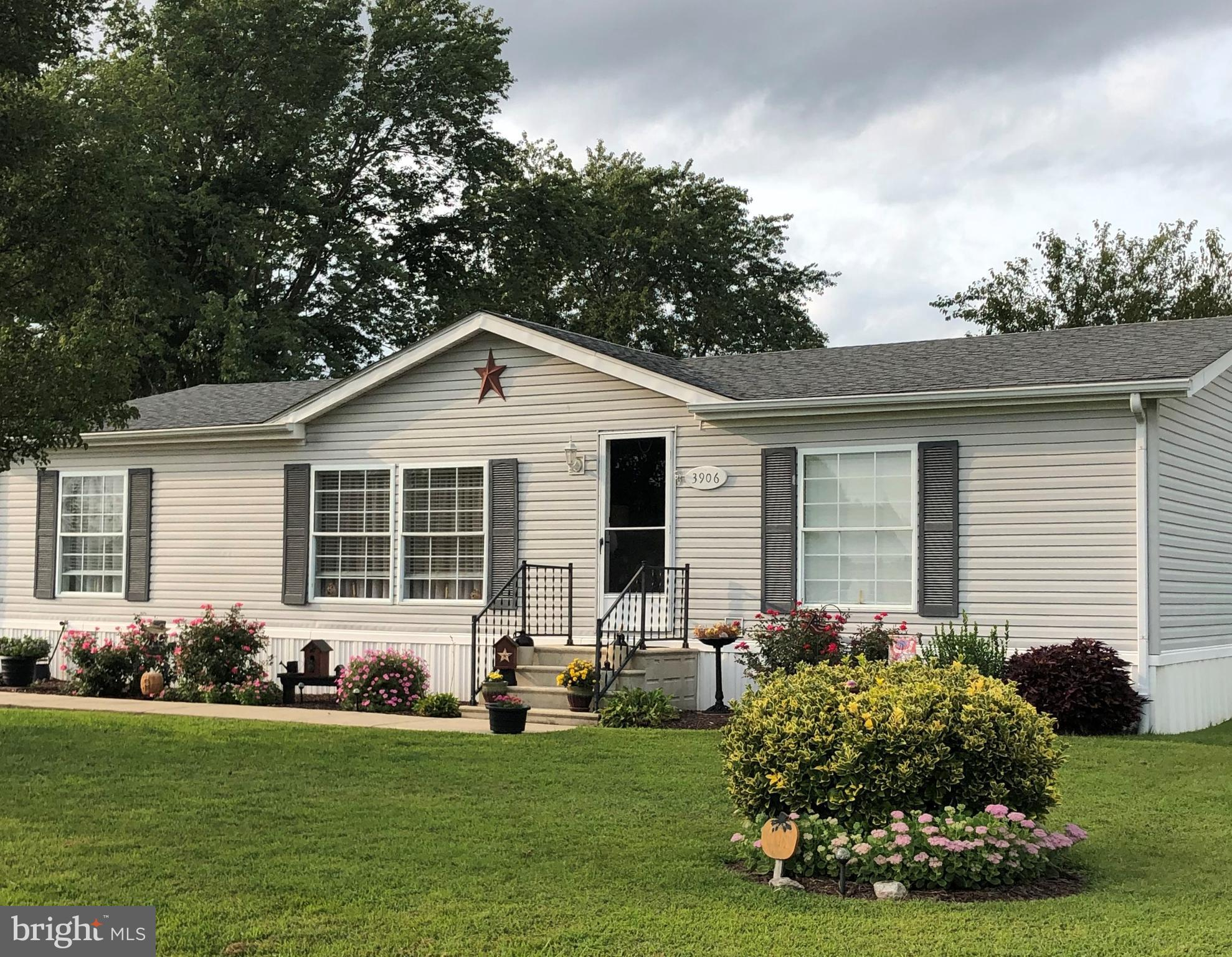 Wonderful like new manufactured home in a nice community.    Inside is neat as a pin.    Nice deck off the rear of home.   Two sheds included  with a third one open for discussion.   Yard is pristine with a variety of plantings.  Come  see this before its gone.    Buyers will need to be approved by park management - rules & regs apply.  Application fee may be required.