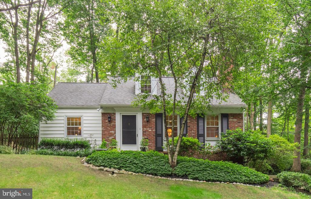 Welcome to 620 Upper Weadley Road.  This lovely brick and siding Cape Cod is located in sought after Wayne and the highly regarded Tredyffrin/ Easttown School District.  The well manicured  .41 acre lot offers peace and an abundance of privacy.  The back yard is fenced and offers separate flagstone seating areas to enjoy your morning coffee or evening dinners.  The flagstone lined front steps lead to a colorful landscaped front garden.  Enter from the front door into a large 20 x 14 LR with a brick, wood  burning fireplace, charming built in nook with shelving, high hat lighting, crown molding and coat closet.  The DR  with chair rail and crown molding opens to the remodeled kitchen boasting a peninsula for seating or prep area with storage, granite countertops, tile backsplash and flooring, SS appliances and an exit to the side yard.  In the hallway there is a pantry closet and a renovated full bathroom with tiled shower and pedestal sink.  A convenient first floor bedroom has two closets and French doors that lead to the back patio.  Upstairs on the 2nd level you will find a large bedroom with 2 dormer windows and a good sized closet, a 3rd bedroom  with a built in shelving nook, and a 4th bedroom that offers access to under eaves storage.  The hallway allows for a linen closet and a 2nd remodeled full bathroom with separate cast iron tub, a tiled stall shower, pedestal sink and built in shelving.  The lower level with renovated powder room adds much desired living space as it is finished with tile flooring .  It also houses the laundry area with access to the attached 2 car garage.  Other highlights include HW flooring on the 1st and 2nd levels and some new windows.  The home has been meticulously maintained over the years, and has been freshly painted.  This home is close to major commuter routes, restaurants, shopping areas and the Septa Regional Rail Line.  Numerous bike paths and Valley Forge National Park are just minutes away.