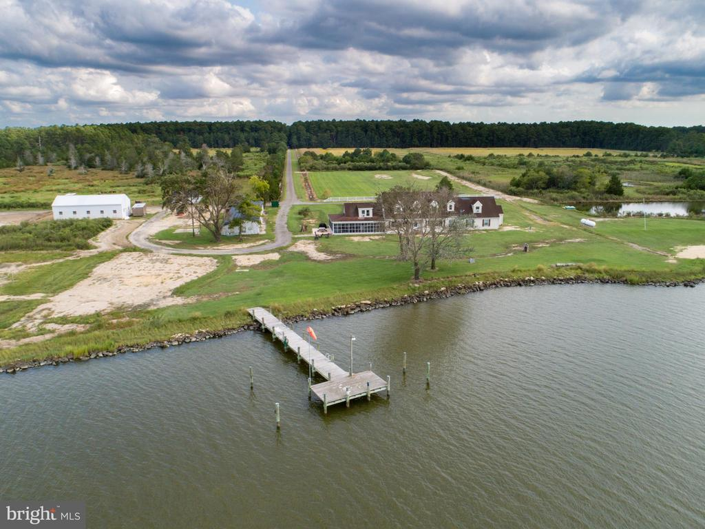 THE SERIOUS OUTDOORSMAN/HUNTER OR NATURE ENTHUSIAST WILL LOVE THIS PRIVATE AND SECLUDED WATERFRONT SETTING ON  357 +/- ACRES.  8000 FT (approx 1.5 miles) OF WATER FRONTAGE ON THE LITTLE CHOPTANK & SMITH COVE WITH SPECTACULAR SUNSETS.  A GATED ENTRY  LEADS TO A PRIVATE TREE LINED  ONE MILE DRIVE OPENING TO FIELDS AND WATER.  BOATERS WILL ENJOY THE TWO MULTI SLIP PIERS, BOATHOUSE, AND  SANDY BEACH TO LAUNCH THEIR CANOES & KAYAKS.  THE 5 BR  RUSTIC FARMHOUSE WITH A WRAP AROUND PORCH  HAS HAD WINDOWS AND HVAC REPLACED. THE OVERSIZED GARAGE & OUTBUILDINGS ARE IDEAL FOR FARM/BOATING/HUNTING  EQUIPMENT & STORAGE.  THE MAIN HOUSE  SLEEPS 15+ & HAS AN ESTABLISHED HISTORY OF RENTAL INCOME +/- $2995 PER WEEK IN SUMMERTIME.  THE 2 BR 1 FULL BATH TENANT HOUSE (OR CARETAKERS HOUSE)  HAS A NEW ROOF (FEB 2020) & NEWER KITCHEN, DECK & SHED  OVERLOOKING THE WATER.  THREE LOTS. 7 MILES  AWAY FROM THE HYATT REGENCY (WITH CHAMPIONSHIP GOLF), SHOPPING, RESTAURANTS & THE BLACKWATER NATIONAL WILDLIFE REFUGE.  PLENTIFUL DEER (WHITETAIL & SIKA), BALD EAGLES, TURKEYS, FOXES, BIRDS, ETC.  SOME FIELDS CURRENTLY BEING FARMED (MILO & MILLET). SEE DISCLOSURES FOR SPECIFIC INFO REGARDING PROPERTY.  SELLER TO ACCOMPANY ALL SHOWINGS & WILL GIVE YOU THE TOUR ON THE MOTORIZED MULE!
