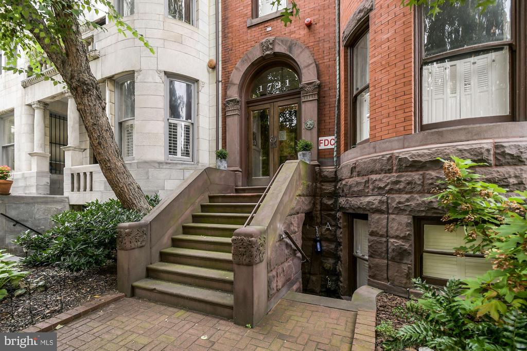 This is a really lovely, unique unit in a grand restored Victorian on one of Dupont's prettiest blocks.  The apartment was completed in 2016 --the building having been totally redone and converted into four units at that time.  All appointments are modern,  high-end and beautiful from the fab kitchen to the gorgeous baths plus more,  yet this apartment retained some of the charming  features of original building including a beautiful large bay window in the front --perfect for watching the world go by; recessed shutters on deep windowsills;  and a gas fireplace.  All this translates into a warm, inviting and and simply charming home. At the rear of the unit is an amazing  large, private deck,  perfect  for everyday enjoyment and entertaining with room for social distancing.  Great closets and storage.  Washer/Dryer in unit. Ask about seller's rental PARKING right behind building. Floor plans soon!