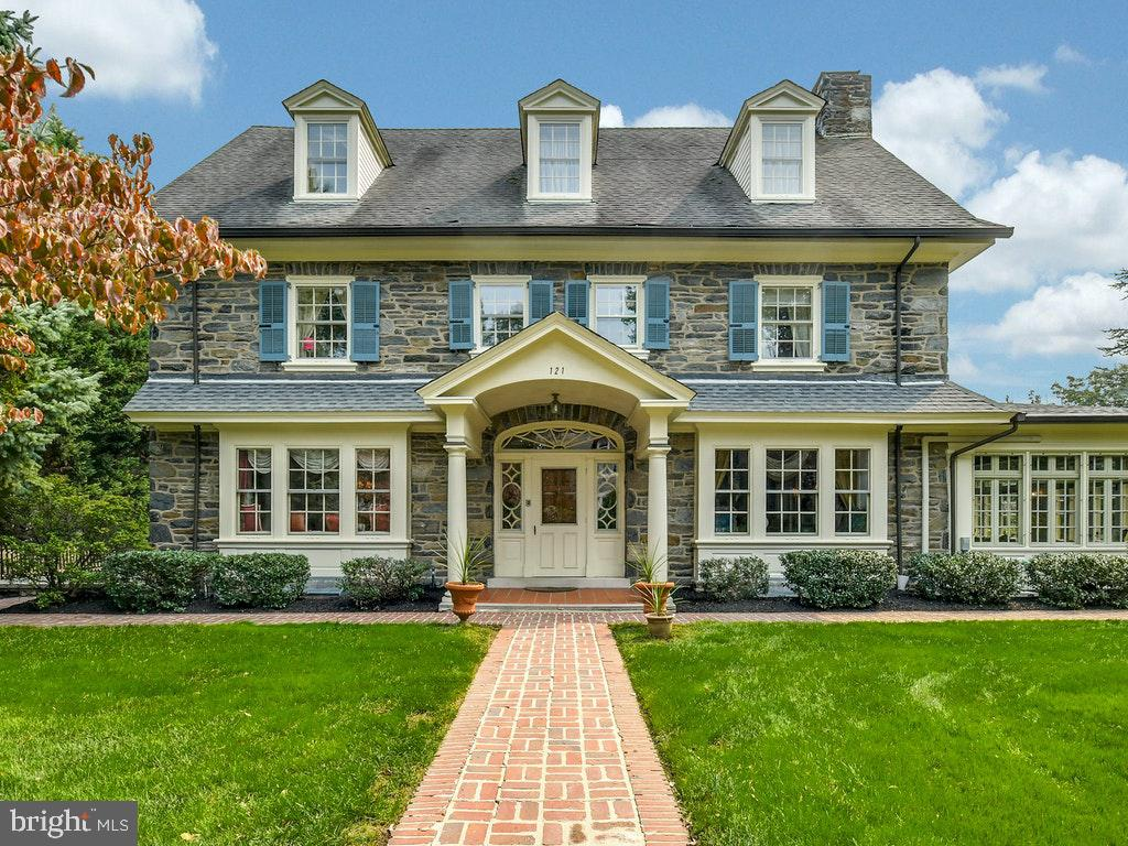 When walking back home to this gracious Main Line stone colonial from all the amenities and fun of Suburban Square and downtown Ardmore  you'll enter into the welcoming large center hall.  You'll be tempted to go into the living room where a fire in the fireplace awaits you or the dining room where you could sit with friends or the kitchen and adjoining family room or to the rear patio to enjoy the pretty back yard. All of these areas boast timeless architectural details!  Up the front staircase you'll reach the Master suite consisting of a bath with steam shower, whirlpool tub, heated floor and adjoining dressing room.  Three additional bedrooms and remodeled hall bathroom complete this floor.  The third floor offers additional bedrooms or flexible spaces for a home office, storage, craft room or whatever your heart desires and two full baths.  Seller is a Pennsylvania licensed real estate agent.