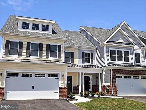 "Visit this home virtually: http://www.vht.com/434107171/IDXS - Overlooking the lovely Branch Canal right on the waterside, this brand new custom carriage-style townhome which is available for Quick delivery in mid to end of October... is a unique opportunity in New Castle County. Located in The Canal District at Fort DuPont. This floor plan features an open concept on the main floor with 3 bedrooms upstairs and a total 2.5 baths. This home also features a 2-car garage. The impressive kitchen is well appointed with granite counter tops, 42"" custom cabinets with trim and soft close hardware and a massive island perfect for entertaining. The owner's bedroom has serene views and spacious walk-in closet. The homes are close to downtown and community boat access for outdoor activities year round. With future shops to include a restaurant, Beer Garden, a Theater district along with an expanded Marina District... making Fort DuPont the new sought after Riverfront in Delaware and the lifestyle you have always craved. With Wilmington, Newark, Dover, Christiana and the southern beaches a short drive away, you will love being close to everything yet nestled in a quiet setting. This home is currently under construction/to be built. Photos are for marketing purposes only and are not of the actual house. The Sales Center is open Monday 2-6pm, Tuesday 11-6pm, Friday 11am-6pm as well as Saturday & Sunday 12-5pm. Home can be shown with scheduled appointment as well. County, City and School taxes are an approximate amount. Homes to be built. Visit the Sales Center."
