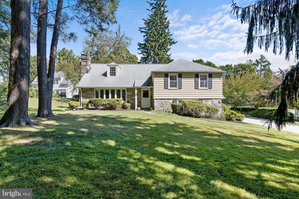 Don't miss this expansive 5 BD, 3/2 BA colonial home in a quiet Bryn Mawr neighborhood in sought-after Radnor Twp. You'll love the huge, scenic, level rear yard! Flexible, split-level floor plan makes it easy to live, work, and school from home during these COVID-conscious times. Enjoy relaxing in front of the fireplace this winter in the large Living Room. The renovated Kitchen features stainless appliances and solid wood cabinets with loads of efficient storage space. Both the Kitchen and the Dining Room open into the bright & sunny Family Room addition, creating great flow for casual everyday living. The lower level features a private room with new flooring, several windows, a closet, and a half Bath which could be used for Office, Exercise, Playroom, In-Laws or Au Pair. Entrances from the driveway lead to that room as well as to the separate Laundry / Mudroom. A 2nd Half Bath, along with coat closets & built-ins, are located on the main floor. Unlike many split-level homes, this property also has a separate Basement for storage & utilities. Upstairs, the Master Bedroom has a walk-in closet & en suite Master BA. Two more Hall BD and a Hall BA, plus two hall closets, complete the 2nd floor. The 4th and 5th BD, a 3rd Full BA, and add'l closet space are on the top floor. Over 3,400 s.f. of living space for everyone to spread out and enjoy! The level driveway is ideal for recreation and you'll enjoy indoor access from the 2-car garage during inclement weather. The rear patio overlooks a wonderful yard, which is bordered by mature plantings for privacy. There is ample outdoor space for a swimming pool, fire-pit, and sports gear. Many rooms have been freshly painted, and most rooms have wood floors, including new engineered wood floors in the Family Room addition. Recently renovated Clem Macrone Park and restaurants in Garrett Hill are just a short stroll away. Close to schools, restaurants, shops, train stations in Villanova and Bryn Mawr, as well as Bryn Mawr Hospita