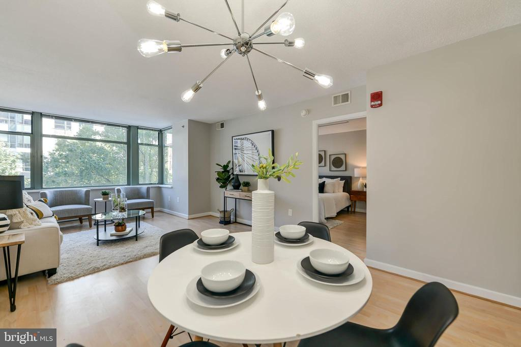 OPEN HOUSE SUNDAY, OCTOBER 4, 1-3 PM.  Sophisticated, bright and spacious, city-chic one bedroom, one bathroom condo with oversized windows overlooks treelined K Street.  The gourmet kitchen features granite counters, stainless steel appliances and opens to the dining area. The spacious bedroom has extensive custom closets and large windows. In-unit washer and dryer. 1150 K St NW is an amenities-rich building with fitness room and large roof deck with grills, conversation areas and views of the Washington Monument. Perfect July 4th firework viewing!  Great location on tree-lined K St, walk to trendy eateries, shops, museums, the National Mall, 3 blocks to METRO center (blue, red, orange, and silver lines). Explore and enjoy all our nation's capital has to offer!