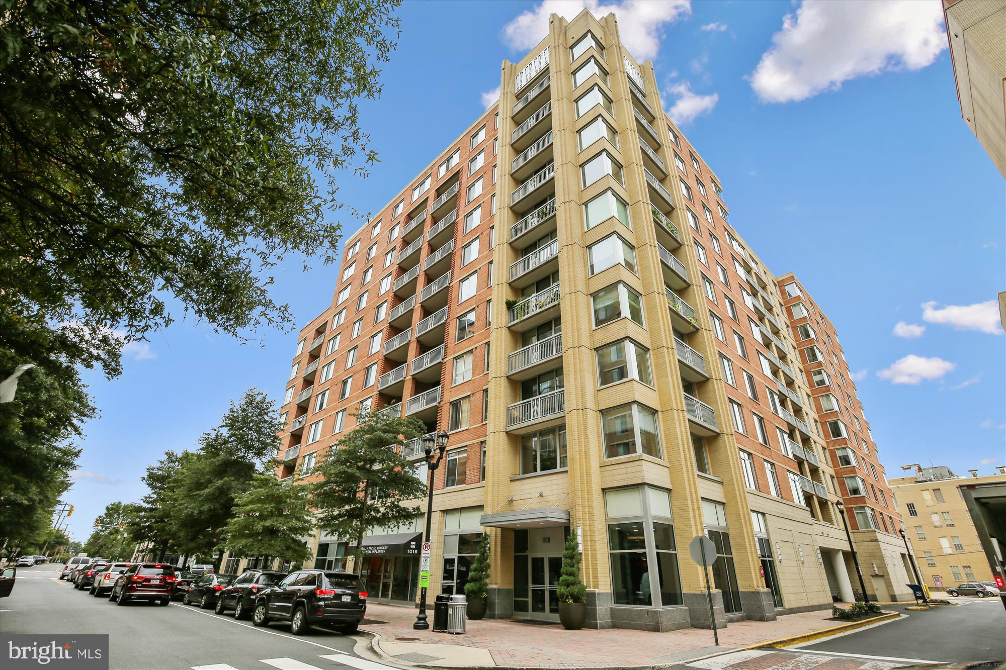 Rarely available 1,281 sq ft corner unit at the popular Phoenix Condo in Clarendon. Great floorplan with large living space, dining area, balcony, open concept kitchen with stainless steel appliances, granite counters, lots of windows, and sunlight. The owner's bedroom has an upgraded walk-in closet with Elfa shelving, carpet, and en-suite bath with dual sinks and shower. The second bedroom has a large closet and balcony access. The 2nd full bath features a tub and large vanity with storage. There's a stacked washer/dryer, new water heater, coat closet, and more storage space in the utility closet. Unit comes with 1 garage parking space close to elevator. Building amenities include a rooftop pool, fitness center, business center, library, community room, courtyard with benches, and on-site management with staffed front desk. Pet friendly, located just 2 blocks from the Clarendon metro. Prime location to Lyon Hall, Clarendon restaurants, Whole Foods, Trader Joes, Clarendon Commons, and more! Extra 16-space parking garage for guests in addition to plenty of meter parking spaces. 2 pets allowed per unit. Extra parking avail for rent $120-140/mo.