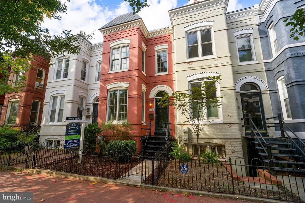 "Welcome Home to Capitol Hill! This newly available, federal style, bow-front row home at 648 G Street NE is conveniently located between Stanton Park and the H Street corridor. It's just a few short blocks from Union Station, Whole Foods, Giant, Union Kitchen Grocery and some of the best shops and restaurants in DC. A 3-level, all brick home, it features 3 bedrooms and 2.5 baths with secure off-street parking and a deep backyard. An entertainer's dream, you can host friends and family for appetizers before heading out on the town. Or accommodate a large fete in your home's main level and backyard.  As you enter the front gate of this home, you'll appreciate its charm. From its classic entry foyer and 9-foot ceilings to its wood-burning fireplace, hardwood floors and sunny bow-front windows, this home is sure to please. With an open living and dining space, the flow is terrific. Just past the powder room is the renovated shaker-style kitchen with newer cabinets, stainless appliances (including a gas range with double ovens), quartz counters and tile floor. If your party is large enough or if you'd just like to dine al fresco, enjoy the spacious stained deck and patio just off the kitchen. Whether it's to barbecue, enjoy your morning coffee or you just need a break between zoom calls, this rear garden is the perfect feature. And just beyond the back fence is secured parking. The rolltop garage door was installed in 2017. Upstairs with hardwood floors continuing throughout, you'll find a large Owner's suite with sunny sitting space, plentiful storage and a renovated en suite bath with heated floors, frameless glass shower enclosure and dual sinks. There are 2 guest bedrooms as well and an updated hall bath with jetted tub. The lower level houses the laundry area. It is unfinished and ready for your designs.  Beyond its charm, this home has practical and money-saving features such as newer windows, updated roofing, tankless water heater, a French drain, a new dishwasher, ""top-down / bottom-up"" shades, cozy radiant heat and owned v. leased solar panels (installed in 2017).  Quietly located on a one-way street in the heart of Capitol Hill, 648 G St NE is in one of the most vibrant neighborhoods in the city. So easy to be part of the national fabric or the local weave with Eastern Market and the Capitol complex are just blocks away. So much culture at your doorstep. In-bounds for Ludlow-Taylor elementary. And easy to access Amtrak, the Union Station or NoMa metro stations or I295. This home is a must-see!"