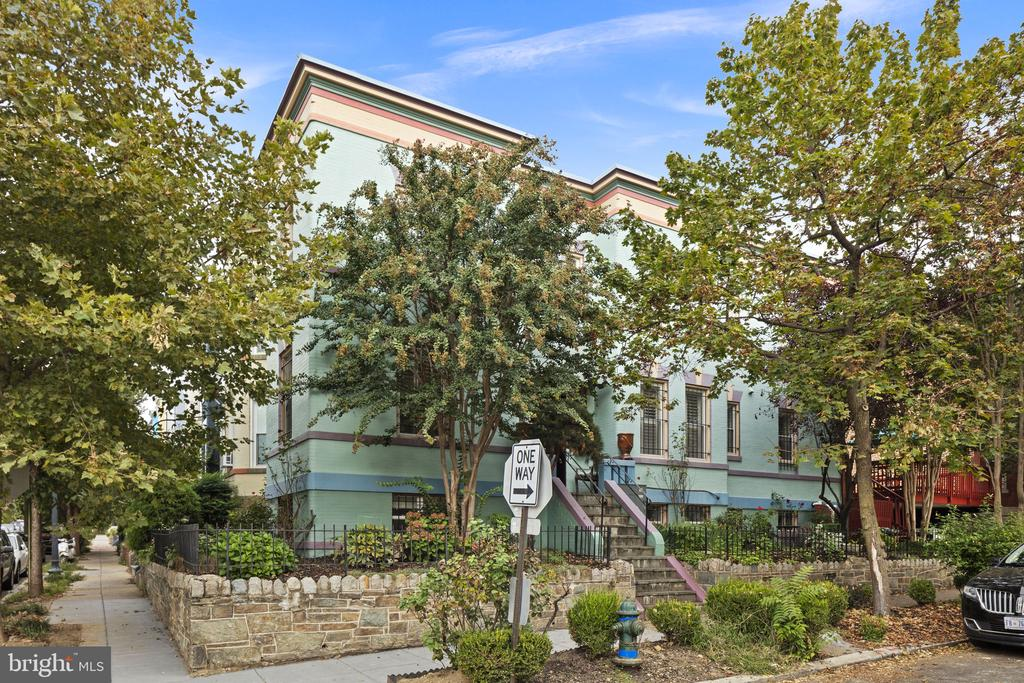 OPEN HOUSE SUNDAY 3/7 FROM 2-4PM! Welcome to 127 W St NW. One of the few corner Grand Dames in the neighborhood, Semi- detached corner lot with yard and gardens. Features include the custom Jeld-Wen solid mahogany front door with glass inlays and the original stained-glass windows on each side, windows with plantation shutters on east, south, and west sides of the house providing great natural light, gas fireplace. A massive private deck perfect for outdoor entertaining, one of the larger decks in the neighborhood. Beautifully renovated subway glass-tiled spa en suite bath with jetted shower and jacuzzi tub, and a separate rental unit on lower level. 2-car carport with off-street parking. This large corner lot is a great investment opportunity - currently rented for $5700/month. Basement/In-law Suite/Rental, accessible from inside living quarters and a separate entrance from carport area, spans the entire length of the house, great natural light, full kitchen with marble tile backsplash, gas range, dishwasher, refrigerator, microwave, and garbage disposal, large bedroom, full bathroom. Lots of closet space, basement laundry area, and high ceilings. Superb LeDroit Park location near U Street corridor. 0.7mi to Shaw Metro and Landmark Theatre Atlantic Plumbing Cinema. Top notch dining and retail, gyms, grocers, coffee shops and live music venues along 8th and 9th Streets. Neighborhood favorites include: Red Hen, Boundary Stone, El Camino, Sylvan Bakery, Big Bear Cafe, Aroi Thai, Baccio Pizza, Pub & The People, Tyber Creek Wine Bar & Kitchen, The Royal, and more. Close proximity to Howard Theatre, community garden, Library, playground, swimming pool, tennis courts and the secret neighborhood gem, Crispus Attucks Park.