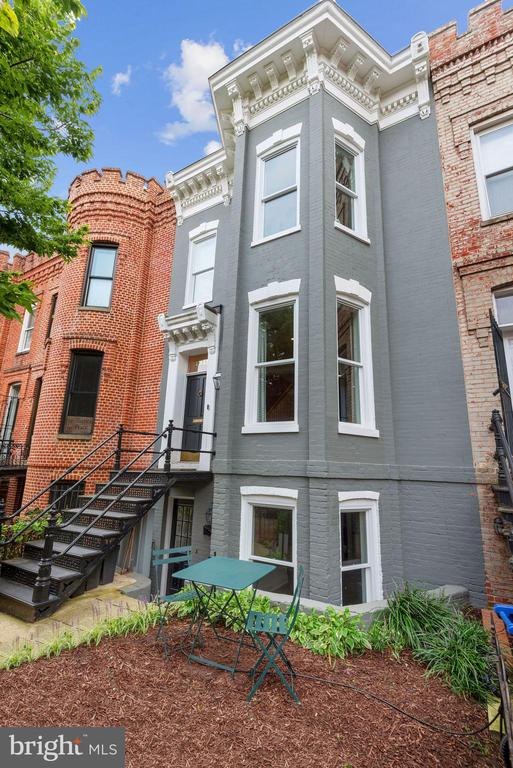 Perfectly situated in the heart of the ultra-hip 14th Street corridor, this historic row home was gut-renovated in 2018 to include touches of modern living mixed with original details including preserved brick walls and windows. This incredibly thoughtful renovation was conceived by Smith Studio and built by BlueStar Design Build. The renovation included full house extension plus a brand-new 3rd floor affording skyline views from a rooftop deck. Featuring 4 Bedrooms upstairs plus a separate 1 Bedroom rental apartment below and a deep garden with 2 car off-street parking. Highlights include sealed white oak floors, Wolf range, Restoration Hardware lighting, Waterworks fixtures, Phillip Jeffries wall covering, Carrara marble, Nest security, rebuilt chimney and fireplace with custom millwork mantle, landscape lighting and irrigation and the list goes on. Nothing was overlooked in this top-to-bottom renovation.