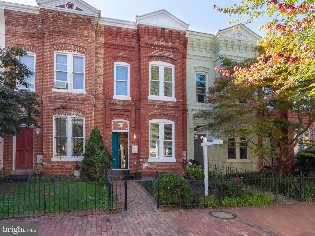Open Sunday 11/29, 1-3pm.  PRICE IMPROVEMENT!  Fantastic renovation (down to the studs) of quintessential Capitol Hill town-home features a 2 story carriage house with garage and in-law suite! The open floor-plan creates a gracious living room, dining room, and kitchen. Upstairs are 3 large bedrooms and 2 full bathrooms.  The serene master bedroom suite features vaulted ceiling and en-suite bath. Great back yard big enough for dining, relaxing and gardening. Through the back yard you will find the garage and above is a fantastic studio apartment perfect for home office, in-laws, etc.  Situated on a lovely block convenient to everything that the Hill has to offer!