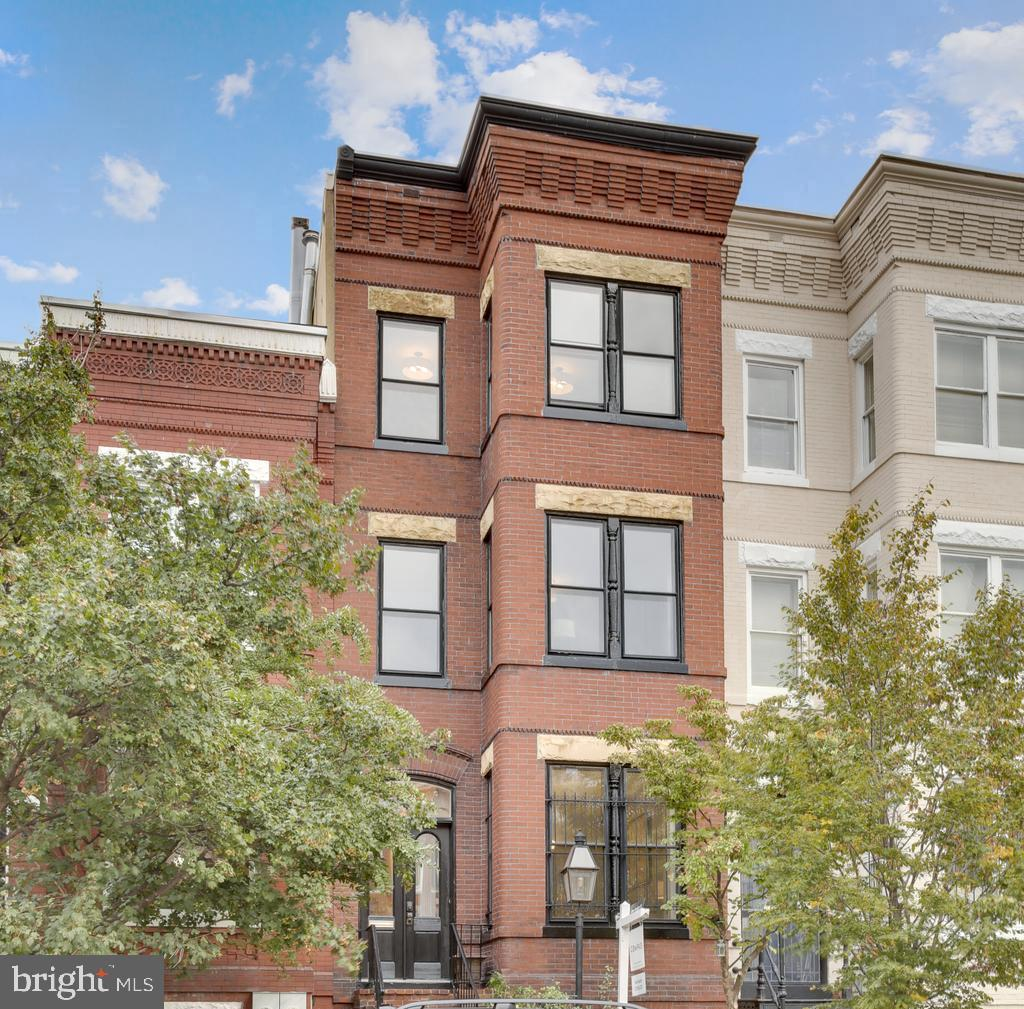 Quintessential Capitol Hill Classic! This 4 level charming Victorian rowhome tastefully blends rare historical details with modern luxuries. Entry Vestibule welcomes you with captivating transom and chandelier setting the tone for a truly unique offering.  The entertaining level boasts 10 ft ceilings, gorgeous heart of pine flooring, antique fixtures, two sets of original and fully functioning pocket doors turning the formal living room into a sun soaked parlor, two wood burning fireplaces (also plumbed for gas) with original ornate mantle pieces. The gourmet kitchen boasts ample cabinet space, luxury appliance package, granite counters, prep sink, elaborate aluminum ceiling and direct access to your own expansive private sanctuary. Second level offers three spacious bedrooms with upgraded lighting, renovated full bathroom and hardwood floors throughout.  The top floor offers a show stopping owner's suite complete with a tastefully renovated master bathroom accented by Carrara marble, designer lighting, period appropriate claw foot tub and frameless standing shower and a custom reclaimed wood vanity.  The master bedroom is flooded with light and sits above the canopy of 4th street, with a walk in close and additional built in closet wall.  Additional space exists for a desk or sitting area in the upper hall so you can look out onto the newly replaced rooftop deck! This offering also features a 2 car garage with direct access to the expansive patio and kitchen. Unfinished basement houses updated mechanical systems, rear walk up entry and tons of extra storage with excellent value add potential.  All of these wonderful amenities await just blocks away from all major public transportation (metro, bus, Amtrak), Union Station, endless shops and Restaurants (H Street Corridor), Whole Foods, steps to Stanton Park and much more. Welcome Home!