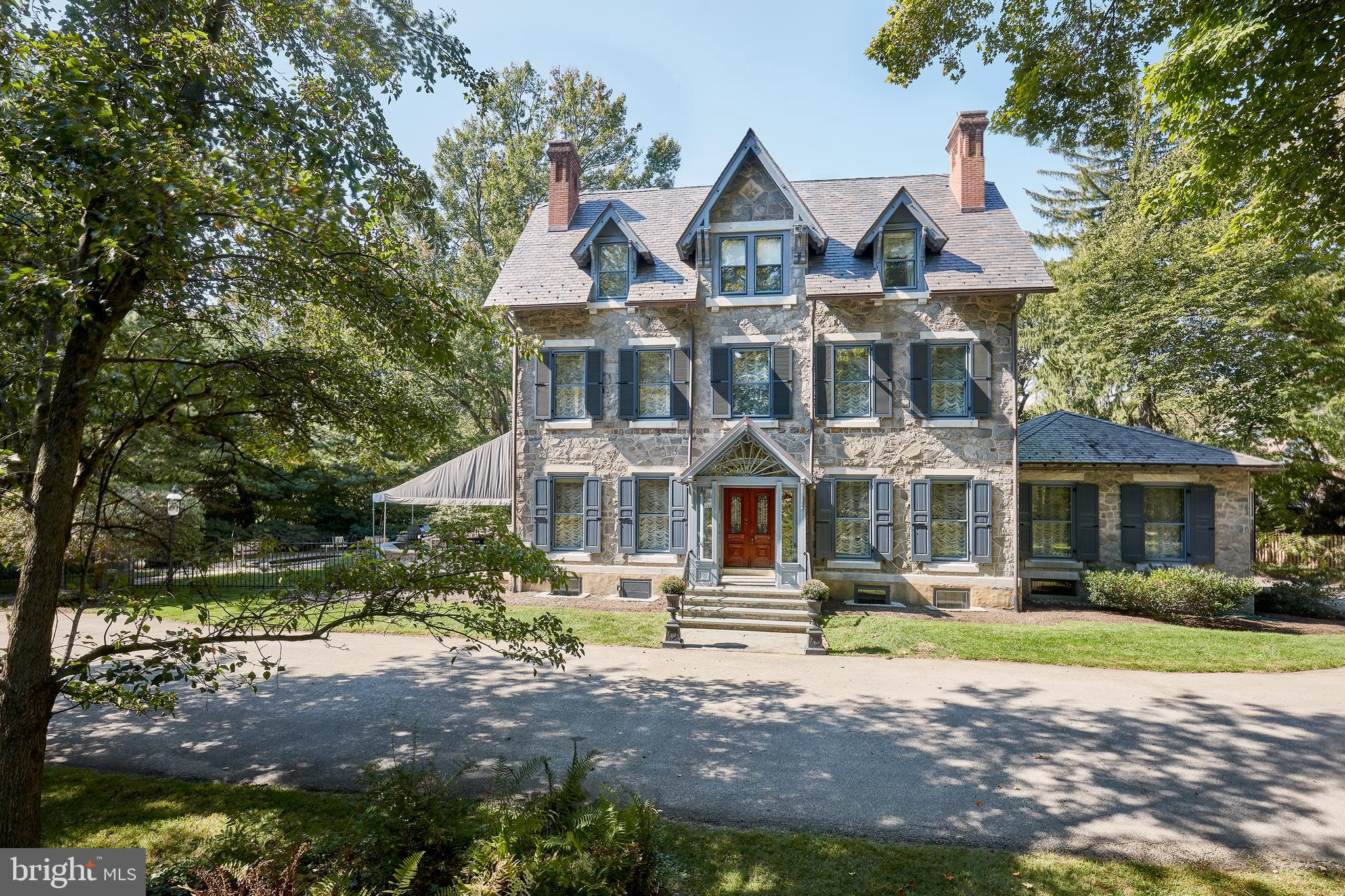 "Exquisitely renovated, sun-filled  stone Manor Home, originally built in 1880, and masterfully brought into the 21st century by renowned artisan, John Milner, with extreme attention paid to every detail and amenity. Enjoy the complete privacy while backing up to conserved Township space in a ""walk to everything including the Radnor Trail"" location. This lovely residence offers stunning original architectural features,  perfectly restored materials, oak floors, massive moldings, millwork, beams and fireplaces of yesteryear,  perfectly blended with newly installed antique light fixtures, multiple office spaces, new Gourmet Kitchen with adjacent Family Room, exquisitely executed vintage-style Baths, new wiring, plumbing, HVAC systems and insulation, 12 foot ceilings with sun-filled floor to ceiling windows and French doors, fabulous Master Suite, and 5 other spacious bedrooms, all set on a flat 3.8 acre lot with room for a pool and tennis court. Dry and fully restored, unfinished basement with exposed stone walls and high ceilings. Easy to finish with a game/ media room, wine cellar and more.  Separate 3-car garage/ carriage house with easy to finish space above! Enter through the stone pillars along the gracious circular driveway, and take in the gorgeous views of the glorious grounds, terraces, outdoor porches and more. Just minutes from the train, renowned private and Radnor schools, shopping, restaurants, 15 minutes from Center City Philadelphia, Philadelphia International Airport and 90 minutes from NYC. Turn the key and move right into this one of a kind treasure. LOW TAXES!"