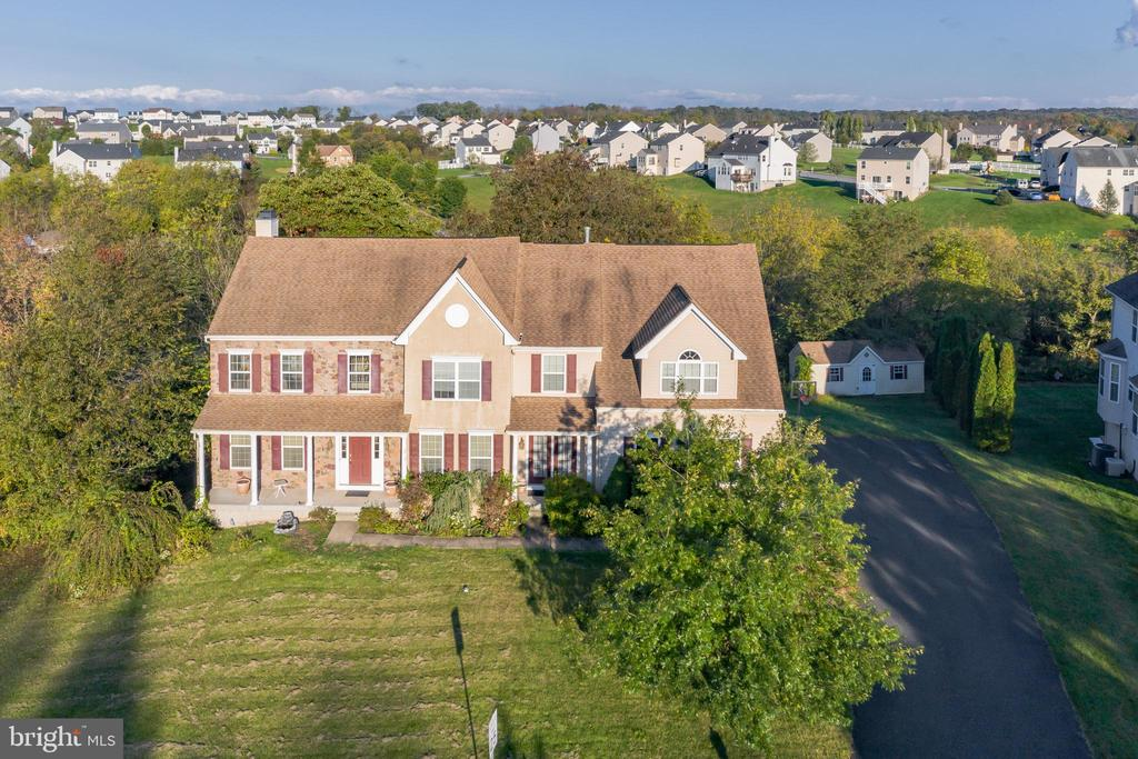 ***Seller is asking for highest and best offers to be submitted by 5:00 PM on Saturday, October 24th. ***                                Are you ready to fall in love with a house?  Welcome to your new home at 113 Shadybrooke S in the highly sought after High Meadows neighborhood and desirable Daniel Boone School District.  This massive 4600+ square foot home is ready for a new owner's personal touch.  Located on a prime 1.3+ acre lot with loads of potential for any new homeowner!  With a little bit of elbow grease, you will see what a spectacular property this truly is.  The house sits high off of the street and has loads of curb appeal.  The 3 car garage is roomy enough for all of your vehicles and toys/hobbies.  The rear and side yards are partially wooded and multilevel.  There is a pathway (currently overgrown) that the seller used to maintain to a lower portion of the rear yard, where there is a clearing with a playset and a small creek running through it.  The portion of the yard closest to the house, also has a nice sized shed for all of your tools and yard games.  Enter through the front door and be wowed by the high ceilings, open concept and massive split/turned staircase in the foyer.  To your left is formal living room and to your right a formal dining room.  Behind the staircase is the kitchen, family room and breakfast/sun room of your dreams.  The space is open and bright with walls of windows to let the sun shine in.  The kitchen has gorgeous granite countertops, a huge island with gas cooktop, double ovens and more cabinet space then you will ever need.  The highlight of the great room is the gorgeous tile fireplace (gas) with carved wood mantle, which is accented by a 2 story wall of windows.  The breakfast/sun room has it's own wall of windows that showcases the partially wooded rear yard.  There is also access to a nice sized deck overlooking the rear yard.  There is also a second deck that is accessible from the rear yard.  The first floor also