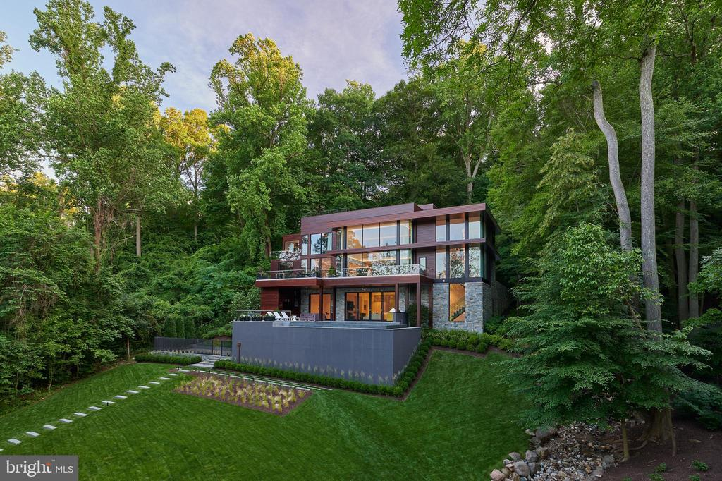 Perfectly sited above the Brookmont Dam on the Potomac, this stunning estate has 180 degree dramatic river views. Nestled in the trees, this luxurious contemporary features 5 bedrooms, 7 baths, multi-tiered decks, an infinity pool and roof top terrace. Completed in 2017 by an accomplished team comprised of leading architects, builders and designers, this newly constructed home is perfect for large scale entertaining as well as everyday enjoyment of the property's natural setting. The 250' waterfront setting provides a dramatic view in keeping with this uniquely beautiful contemporary residence.  Be sure to view virtual tour for additional photos. Further information about this residence can be found under Documents.
